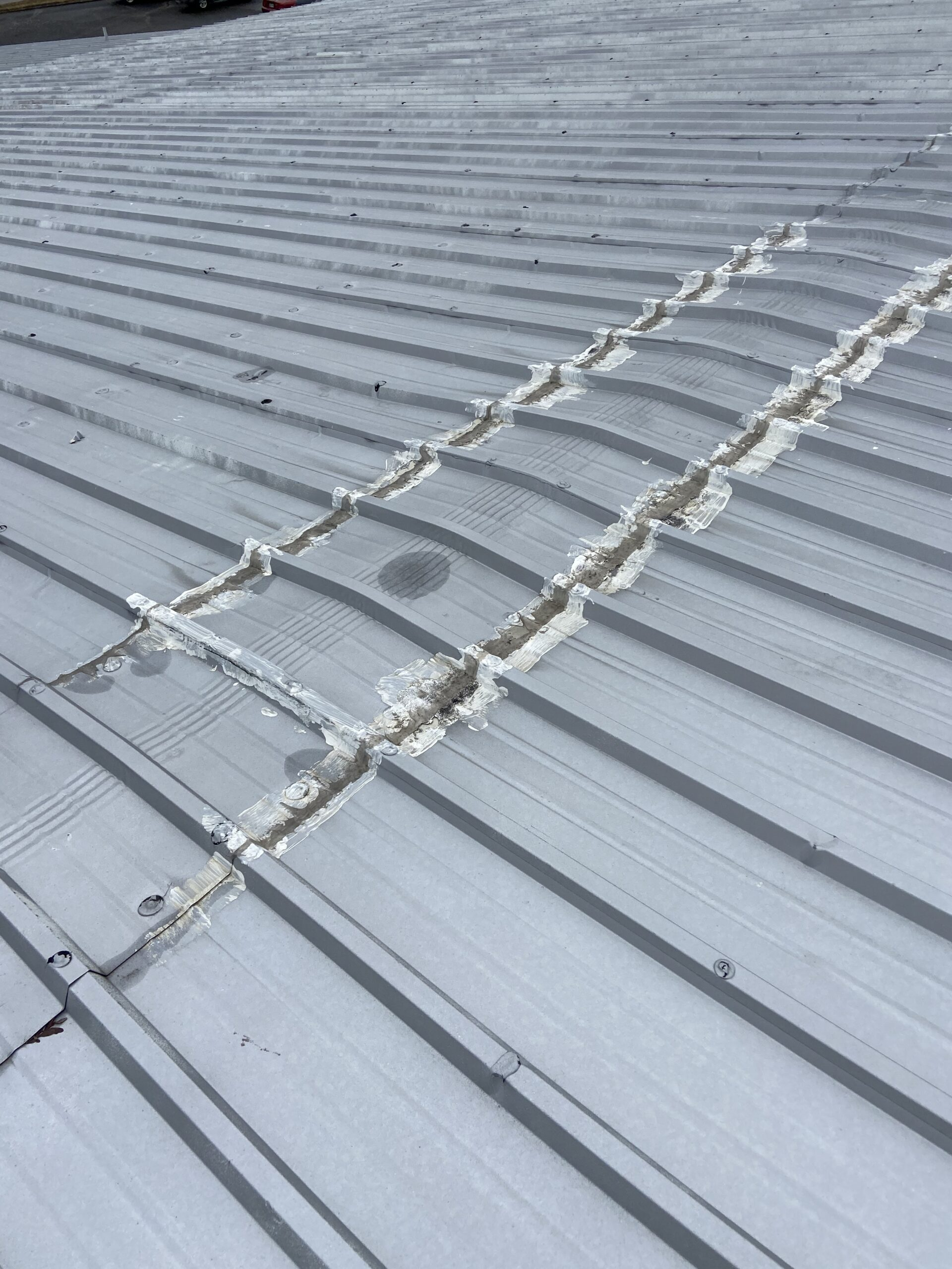 This is the ridge of a metal roof that has leaks