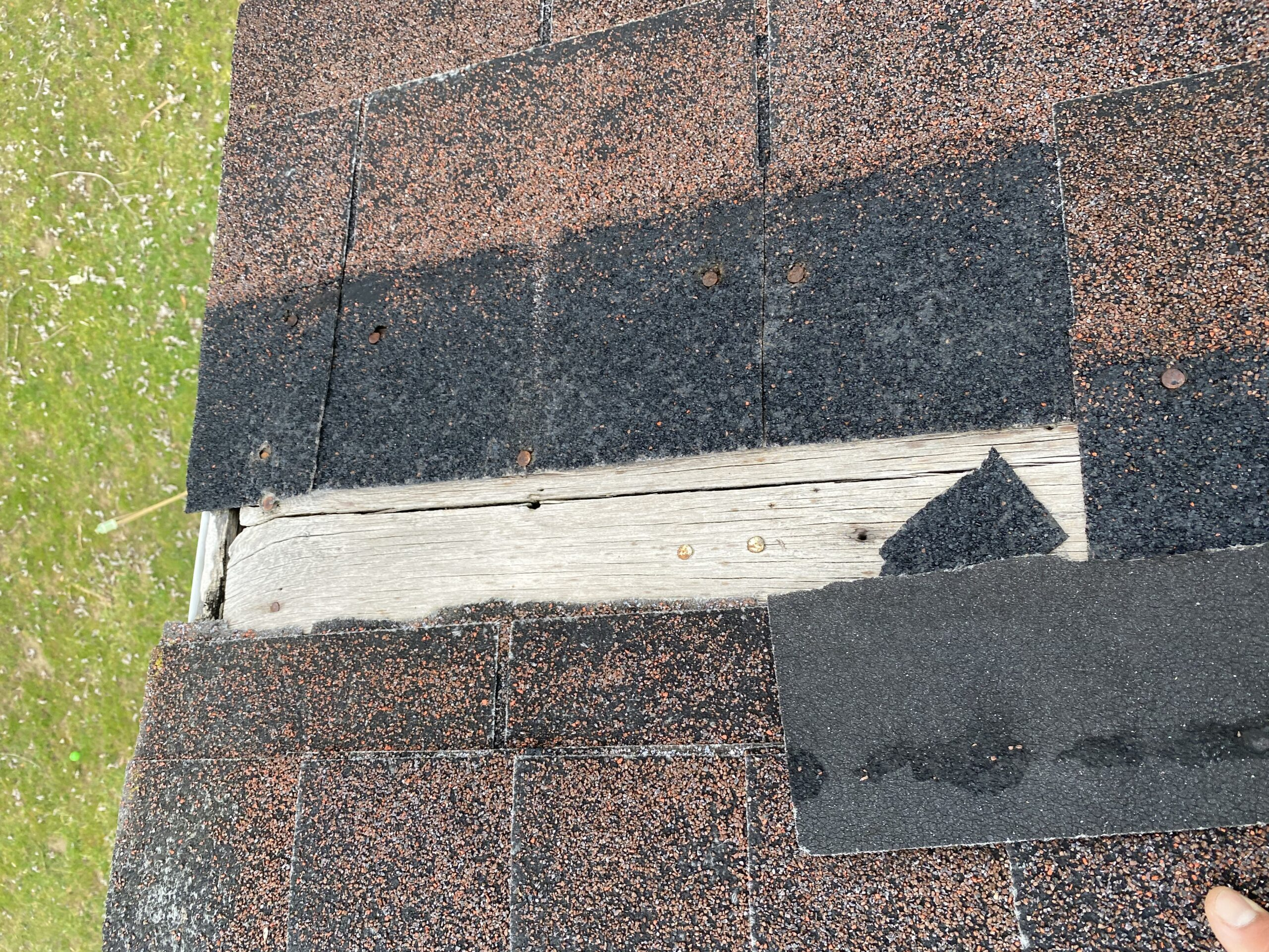 This is a picture of exposed wood on an old brown roof