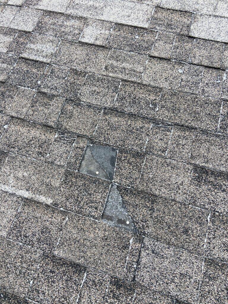 Windblown shingle on a roof in Dandridge Tennessee