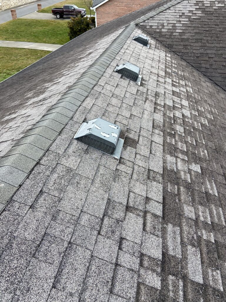 This is a Grey Shingle With roof damage