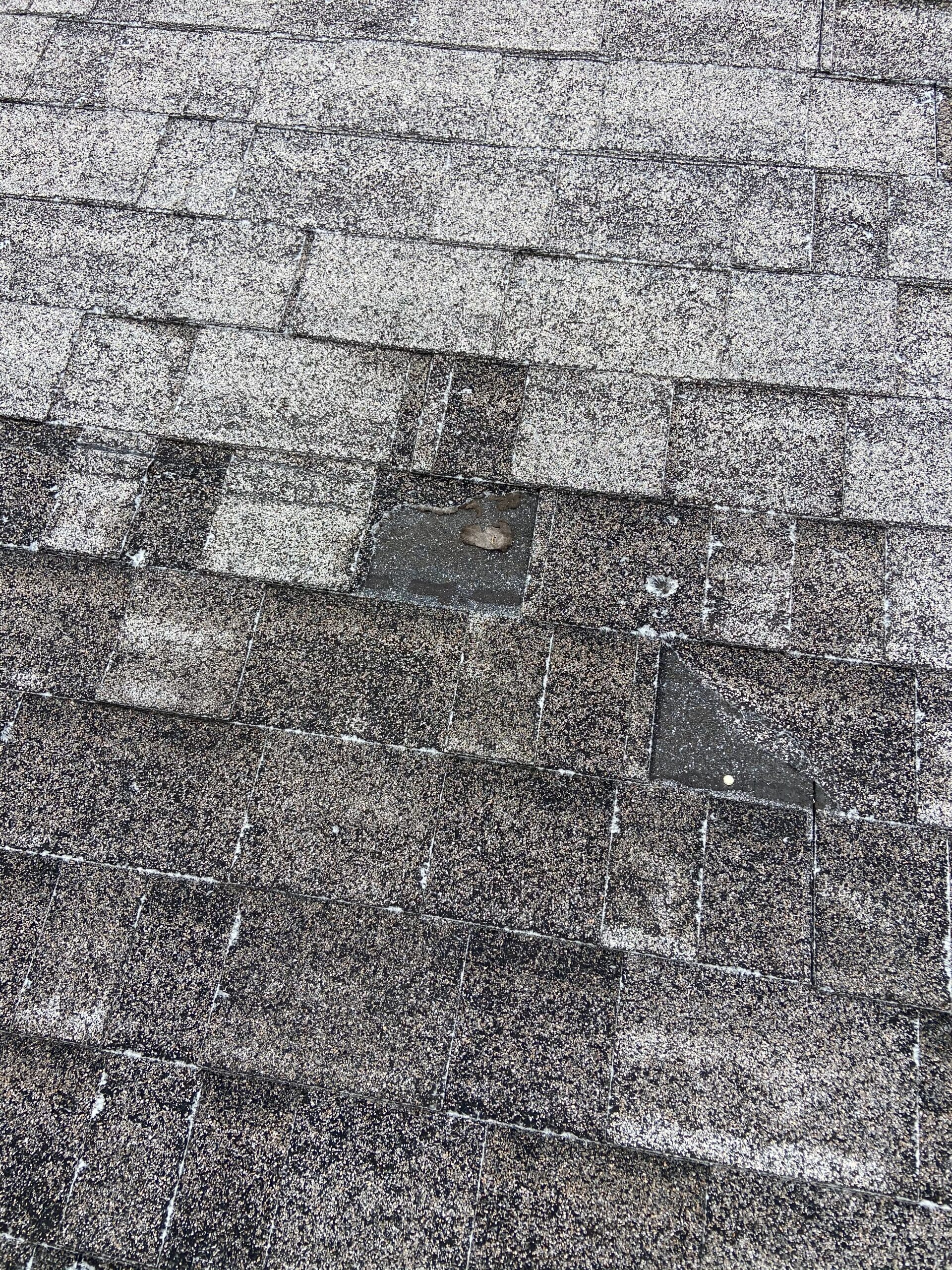 This is a picture of a gray shingles that has storm damage wind and hail