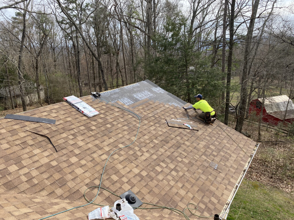 This is a picture of new atlas shingles being installed with synthetic underlayment.