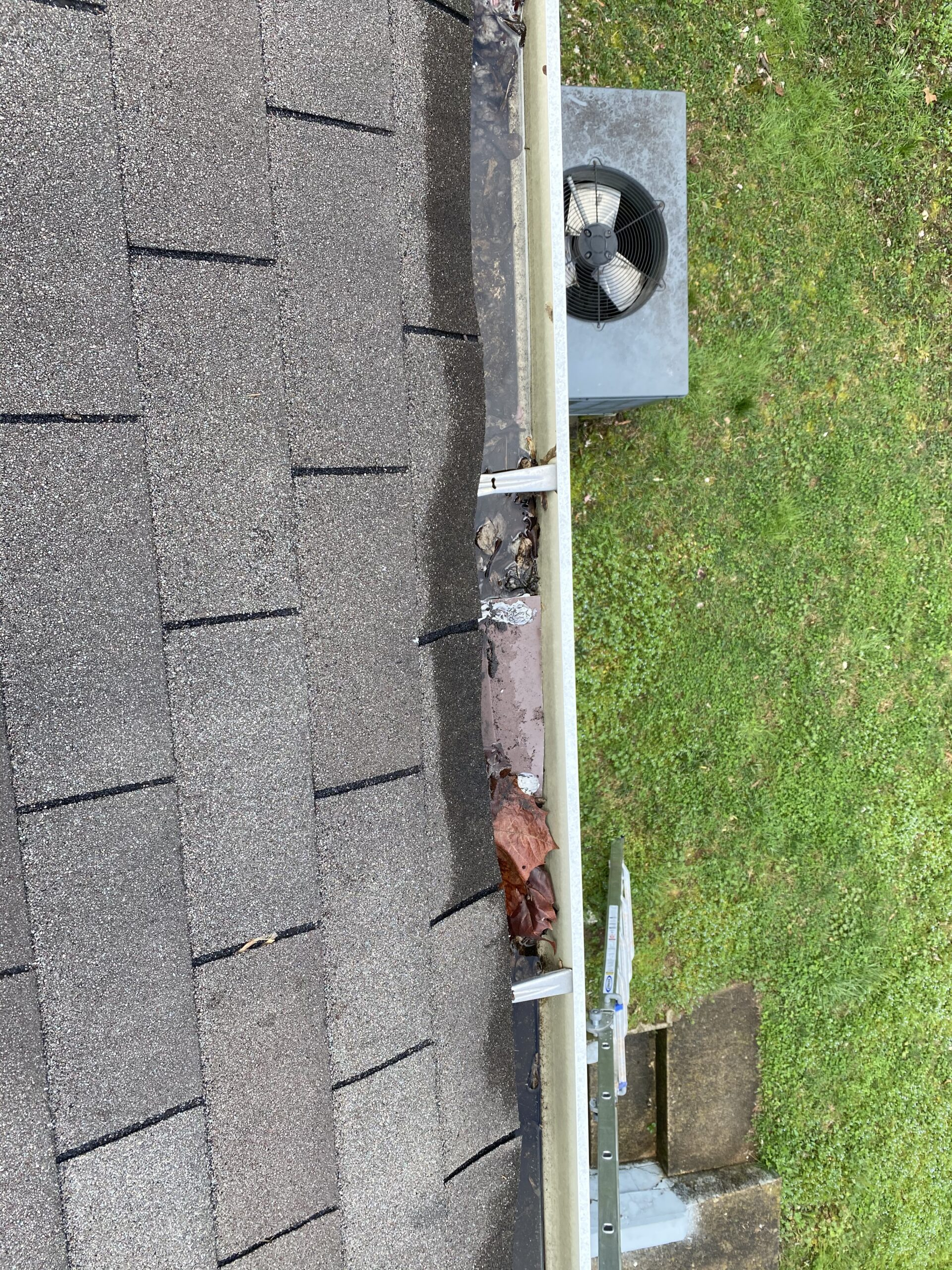 This is a picture of the edge of a roof where water sits at the shingles
