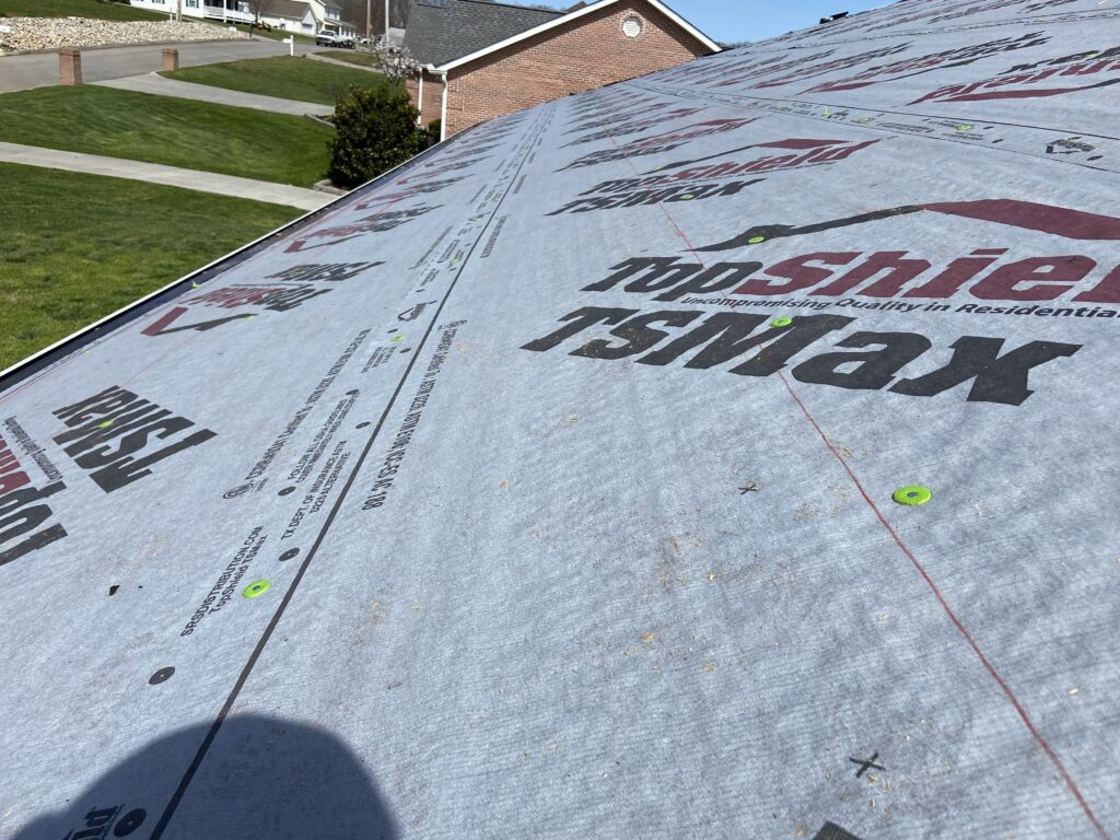 Adding synthetic underlayment on a roof