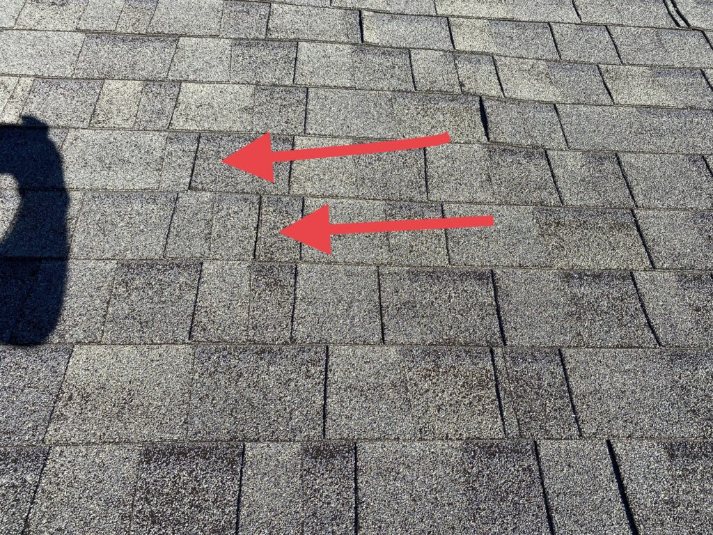 This is a picture of a gray shingle with arrows showing the unions