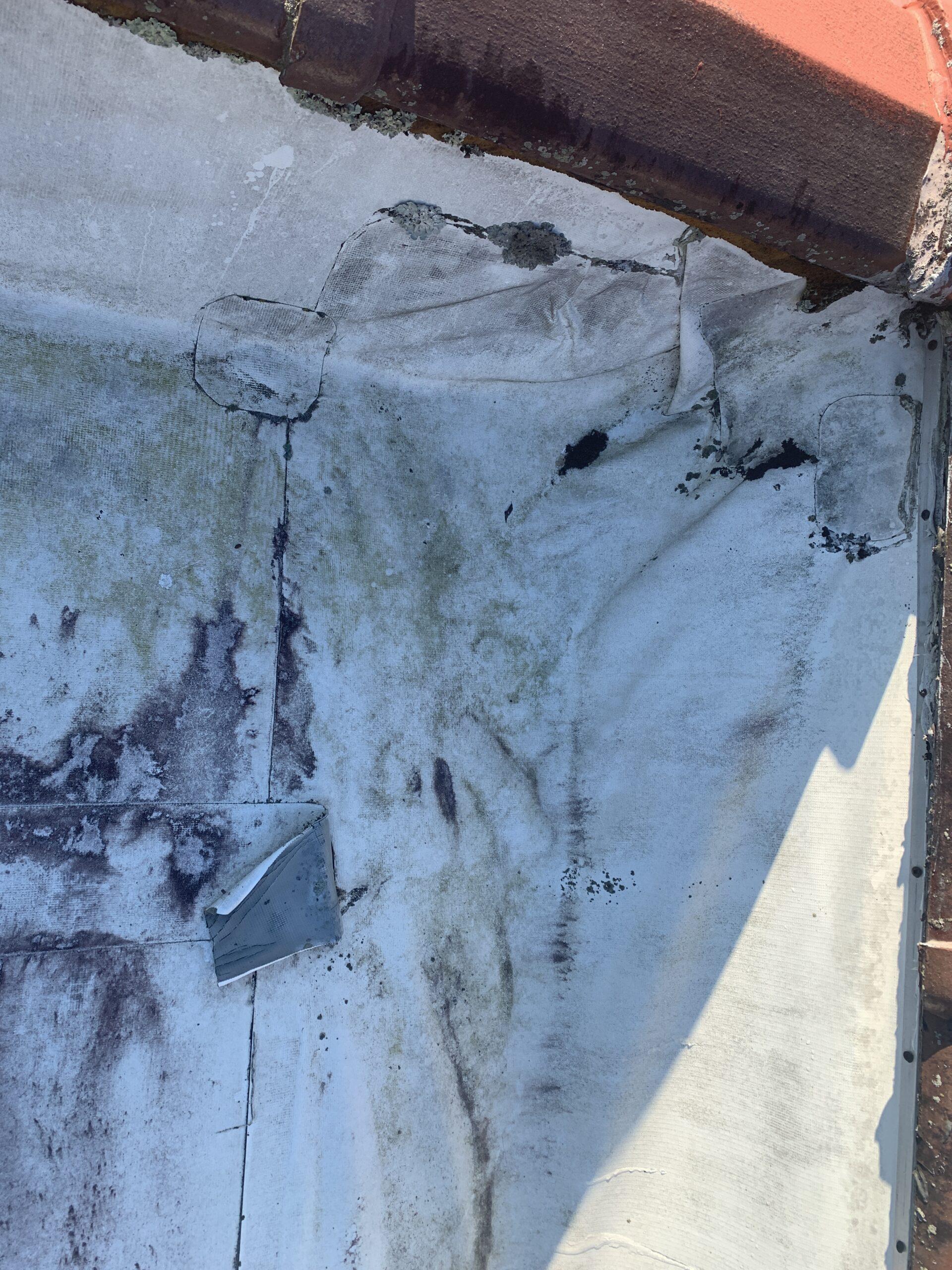 Photograph of bad TPO membrane at parapet wall corner