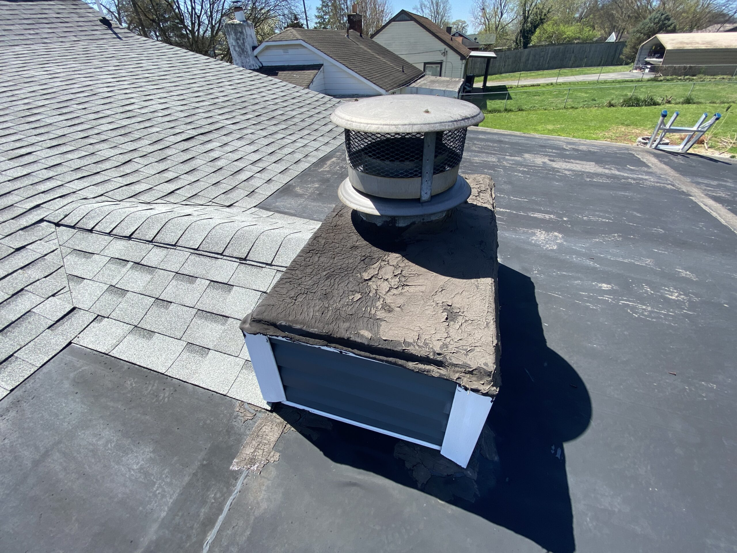 This is a picture of a chimney with cracks that needs to be coated