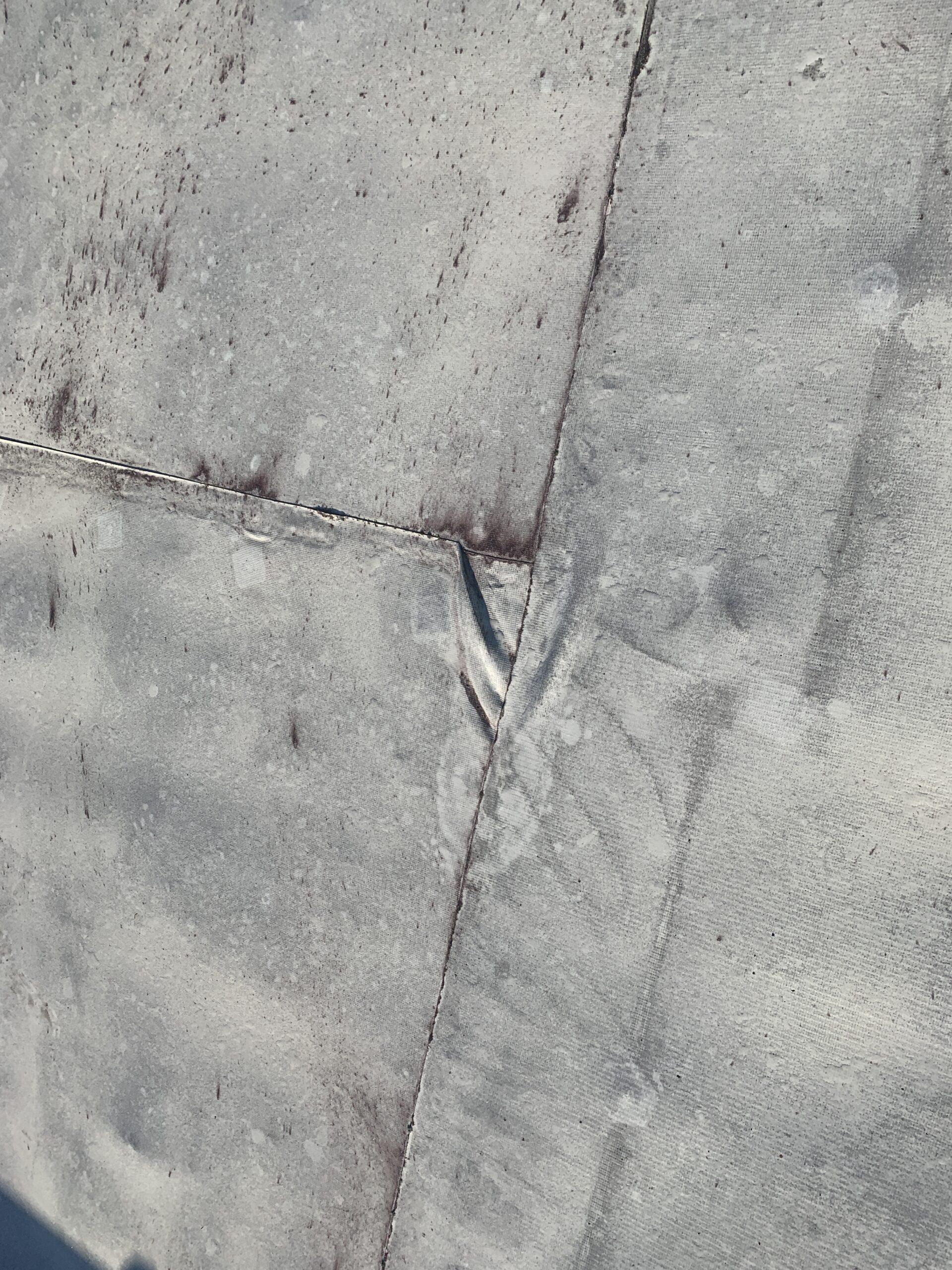 Photograph of tear in TPO membrane