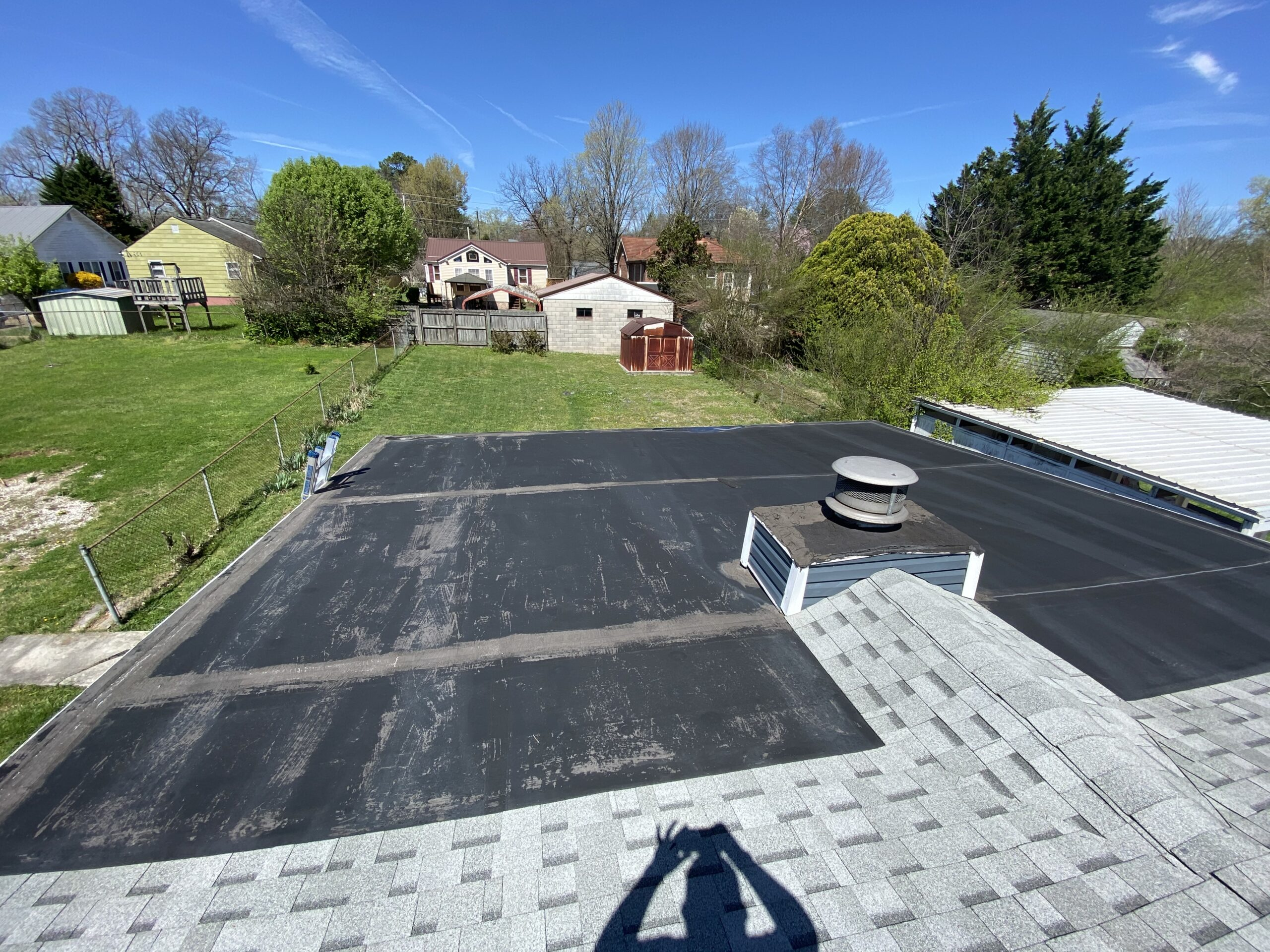 This is a picture of a black flat roof on a carport