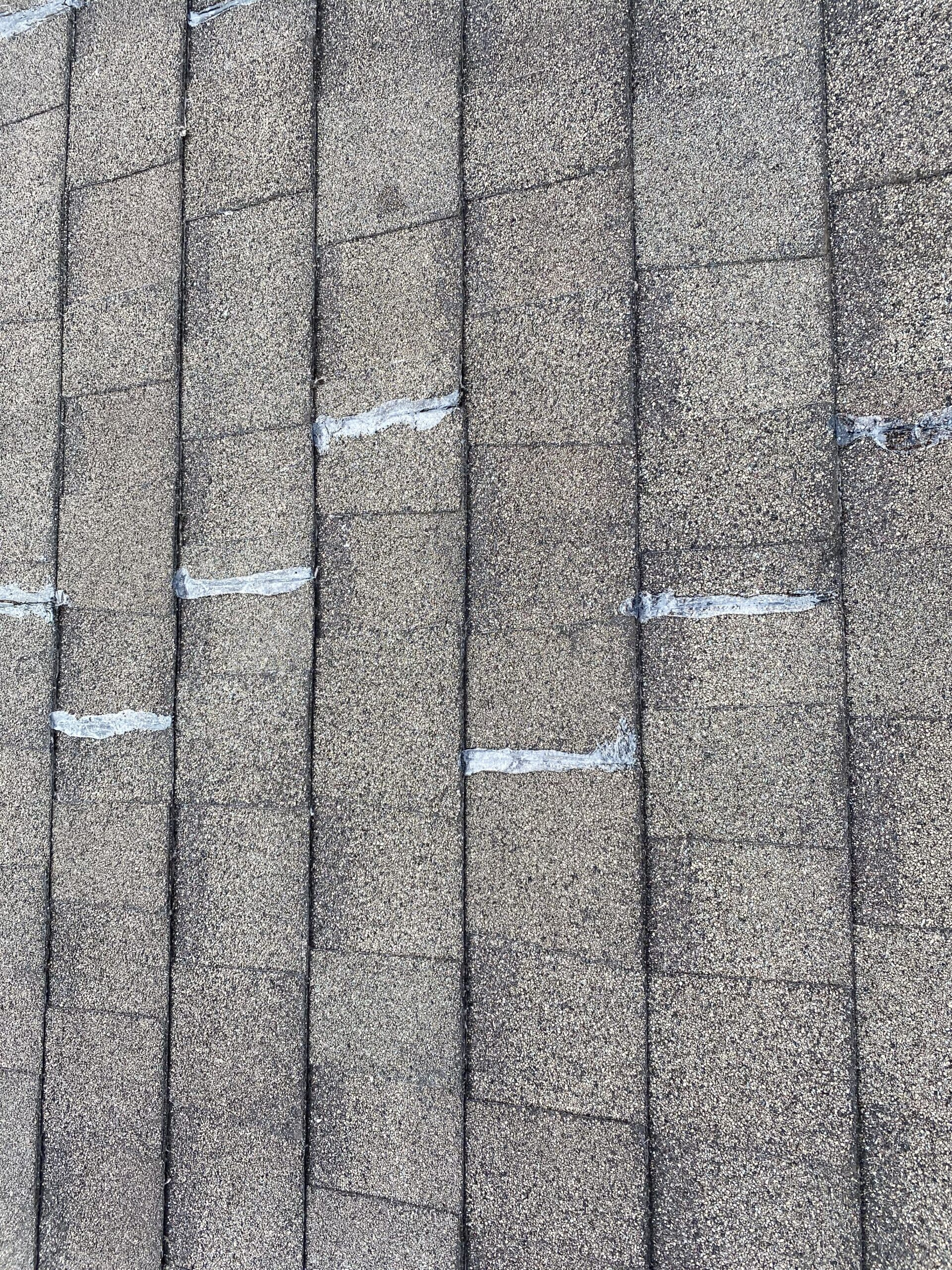 This is a picture of the unions of shingles that have been sealed with clear caulk