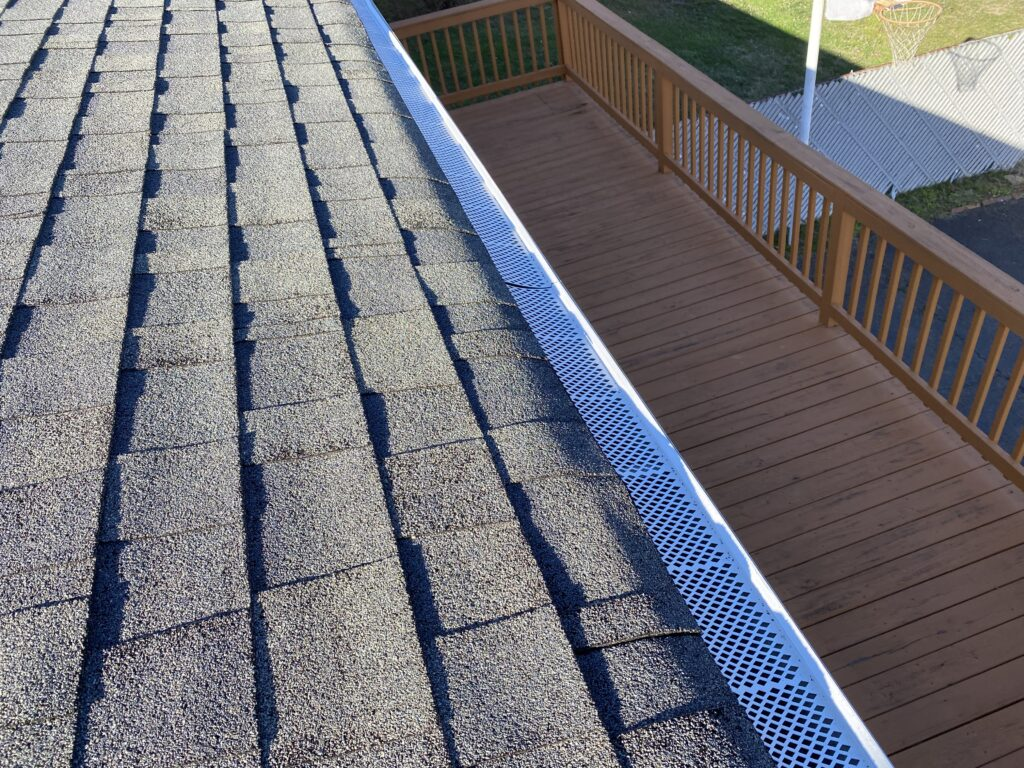 This is a picture of white gutter guards that are in good condition
