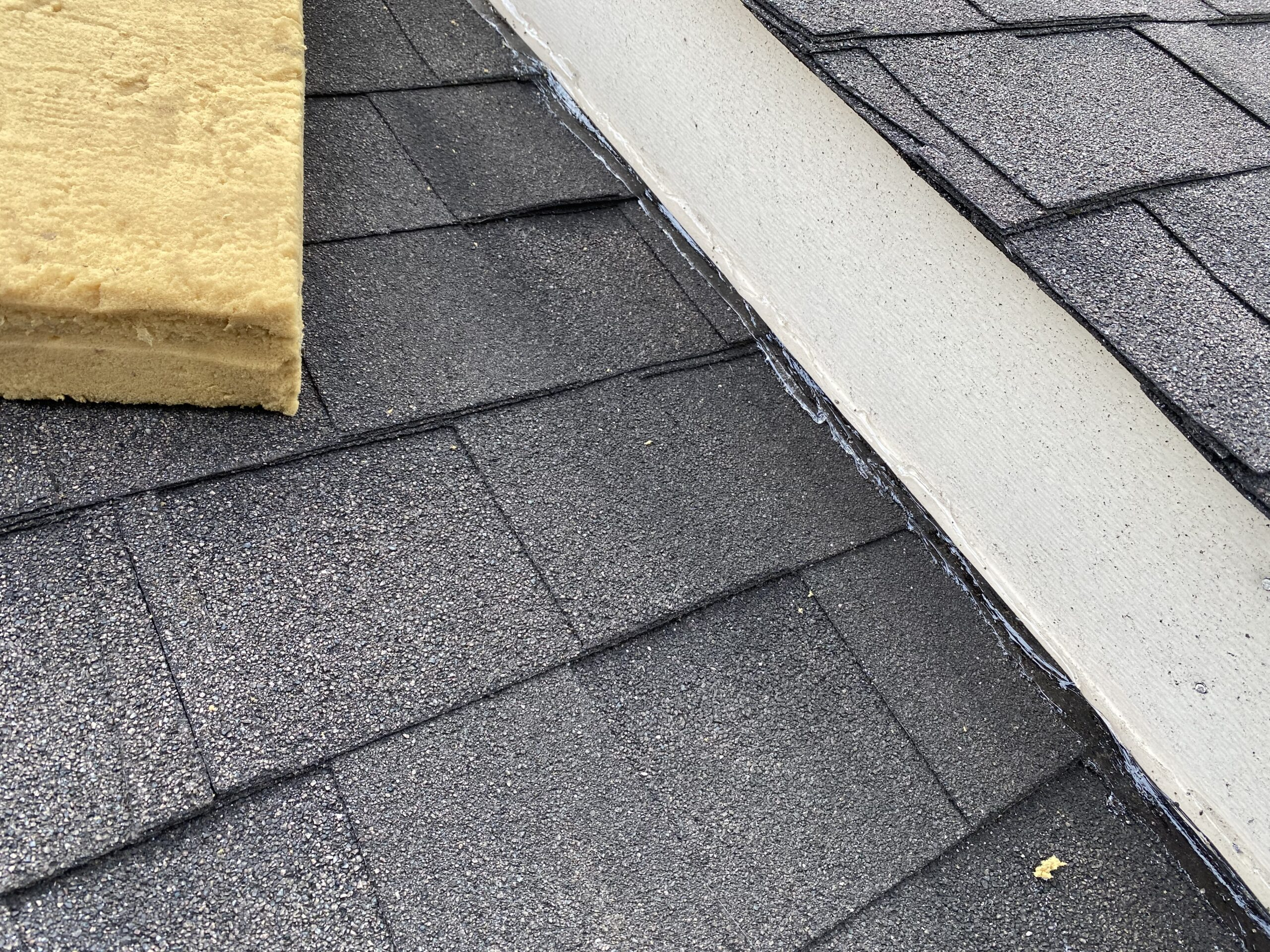 This is a picture of a roof line that was completely sealed with clear caulk