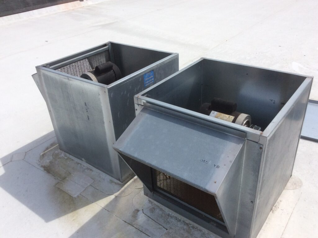 This is a view of AC units on a white flat roof