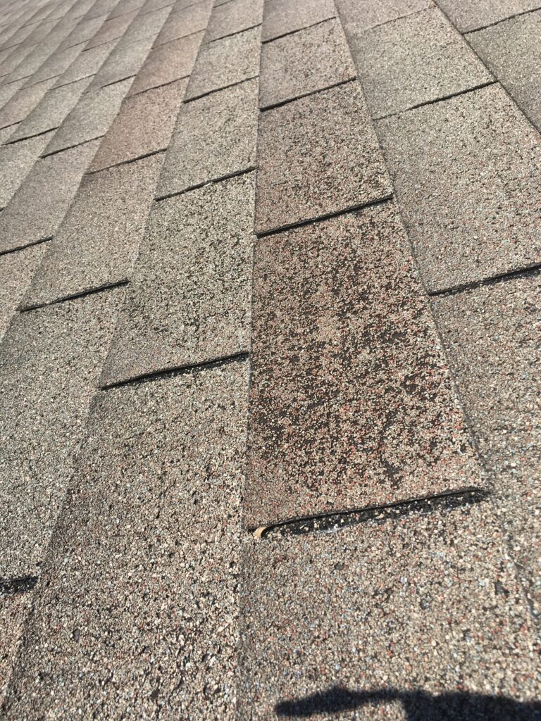 It's a picture of a shingle with missing granules but due to old age