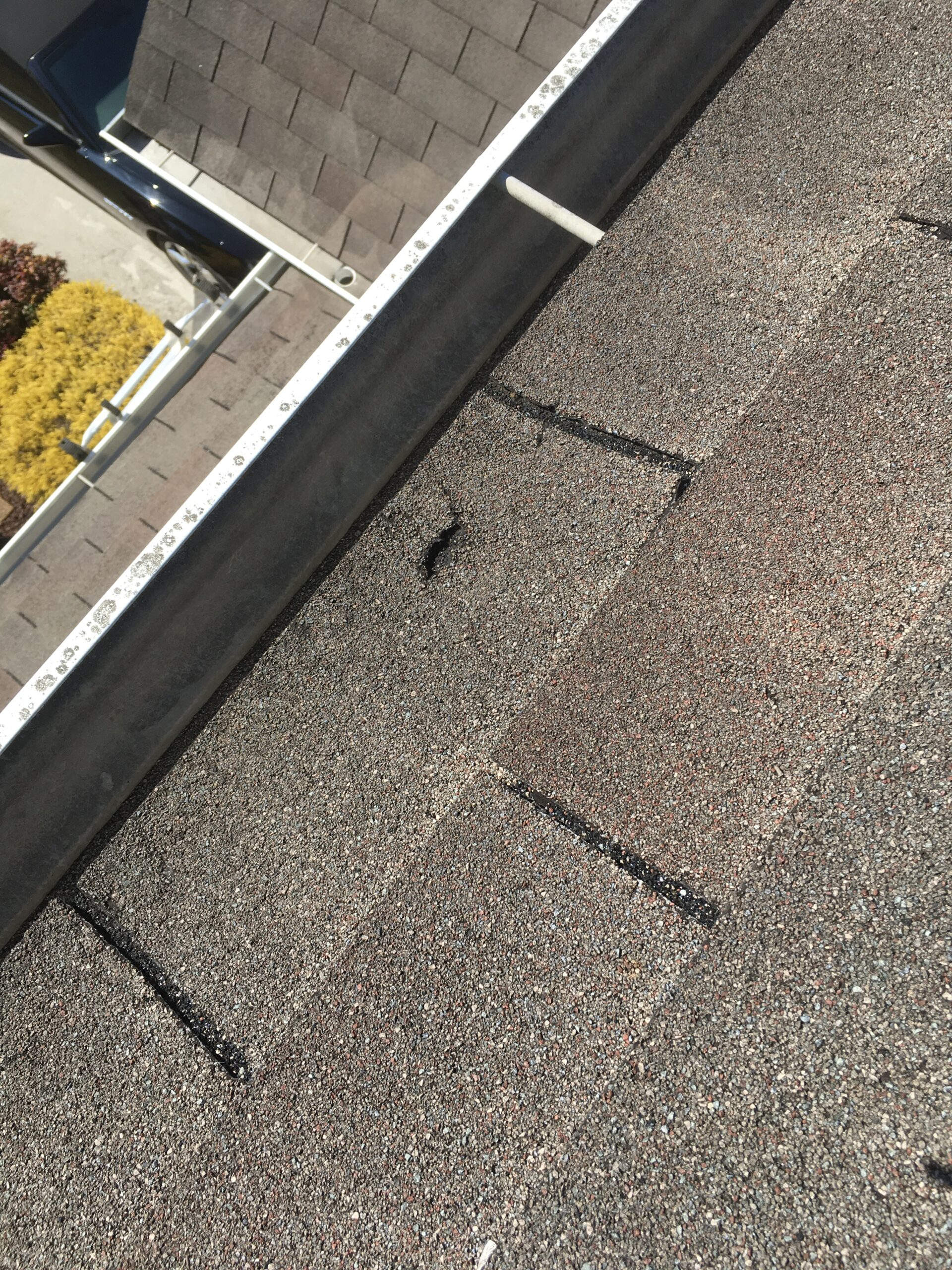 The shingle on the edge of the roof has cracks