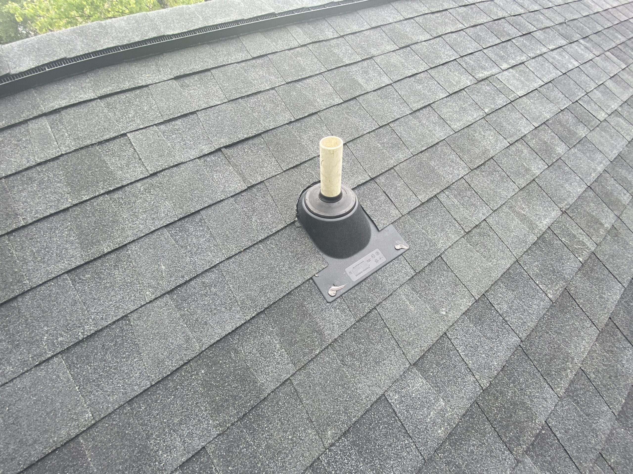 This is a picture of a new pipe boot on a new roof