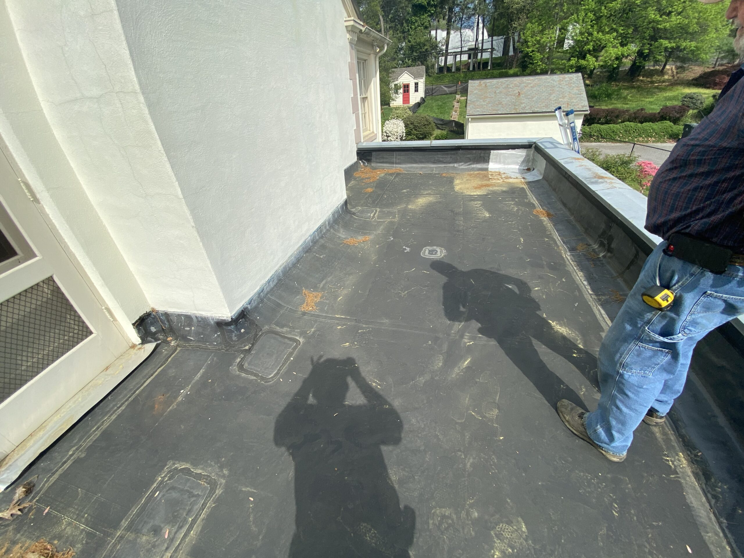 This is a picture of a black EPDM flat roof that has had repairs done to it