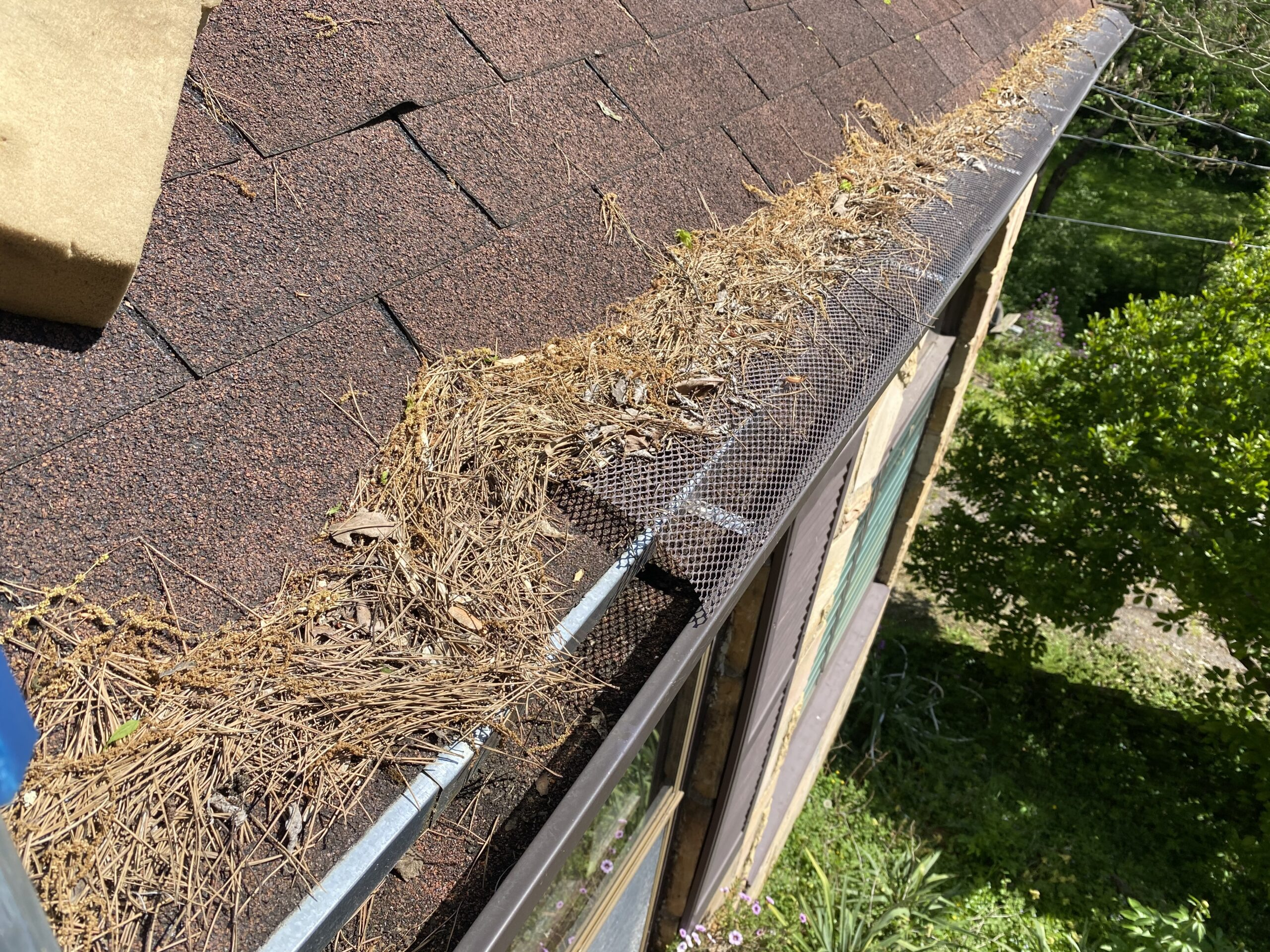 This is a picture of gutter guards that are missing in a gutter