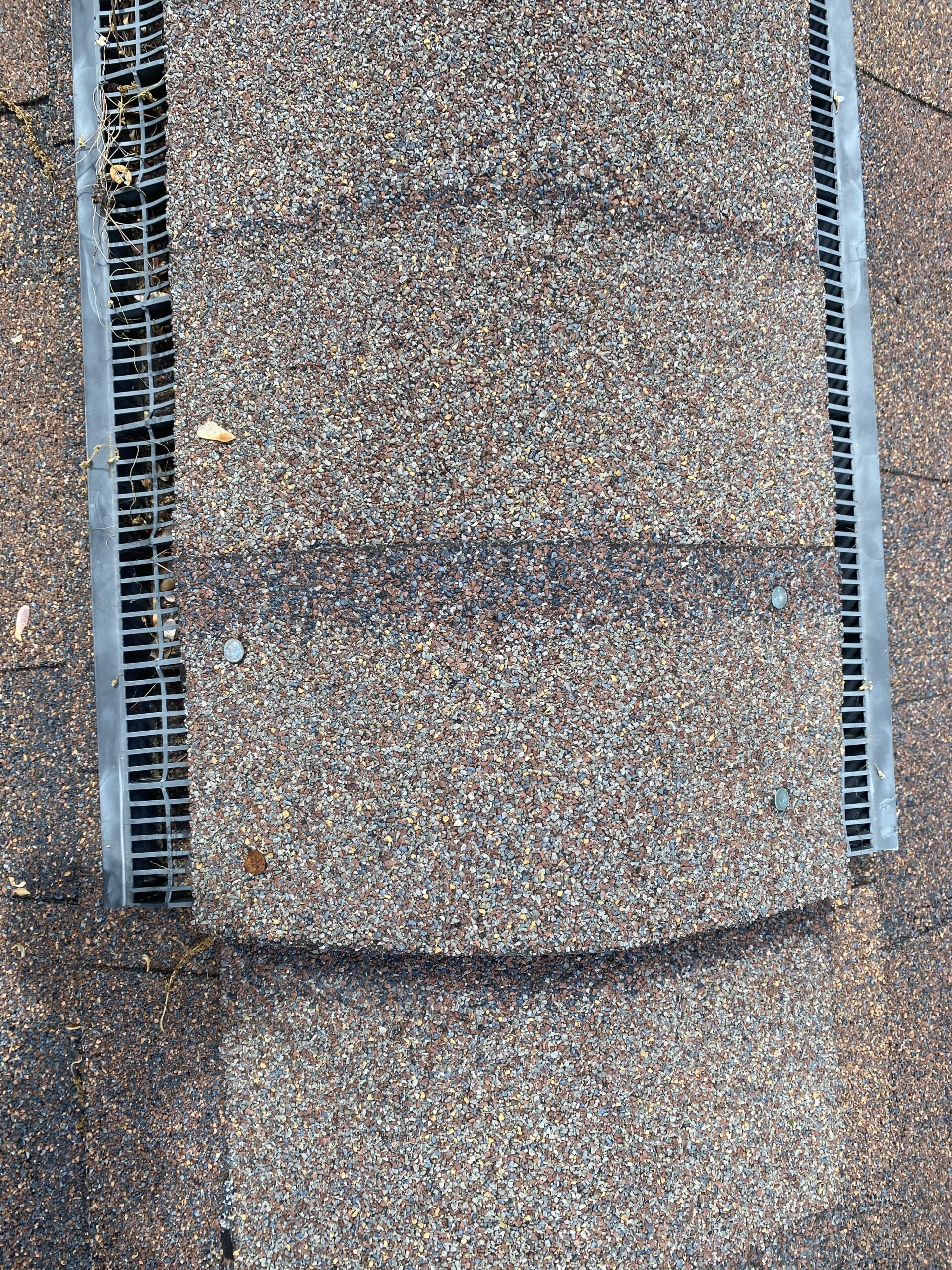 This is a picture of exposed nails ona ridge vent