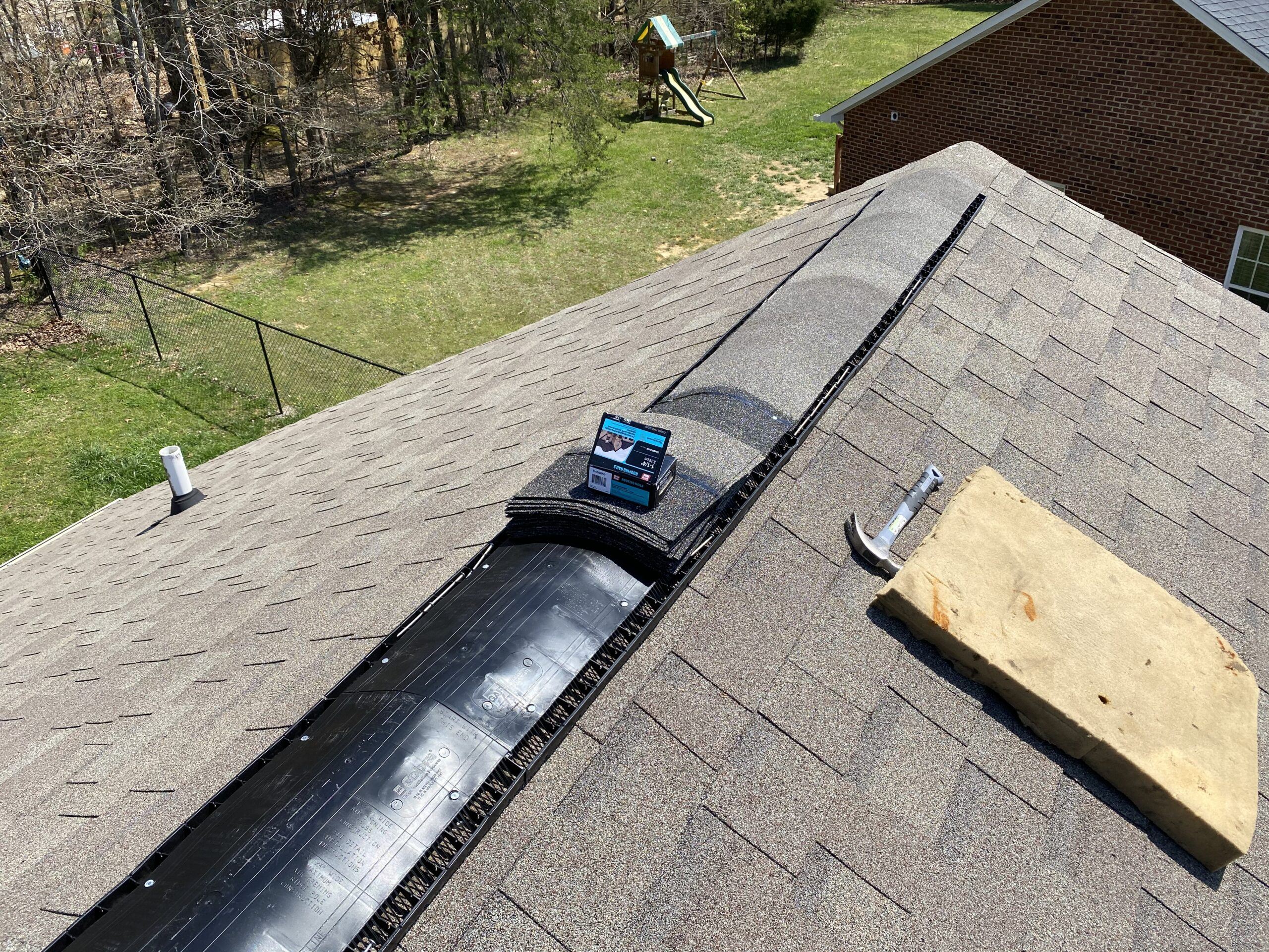 This is a picture of a new GAF ridge vent with weather wood ridge cap shingles.