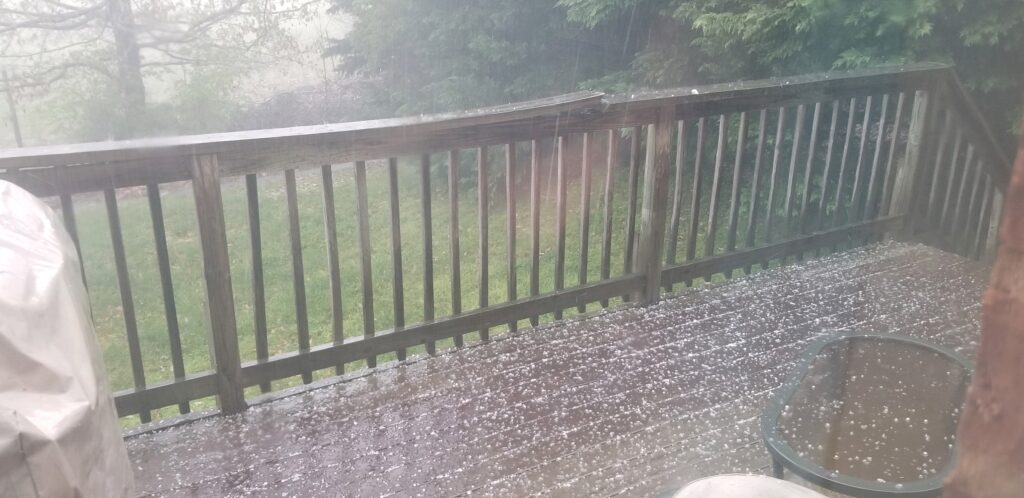 Very small hail hitting a roof and deck