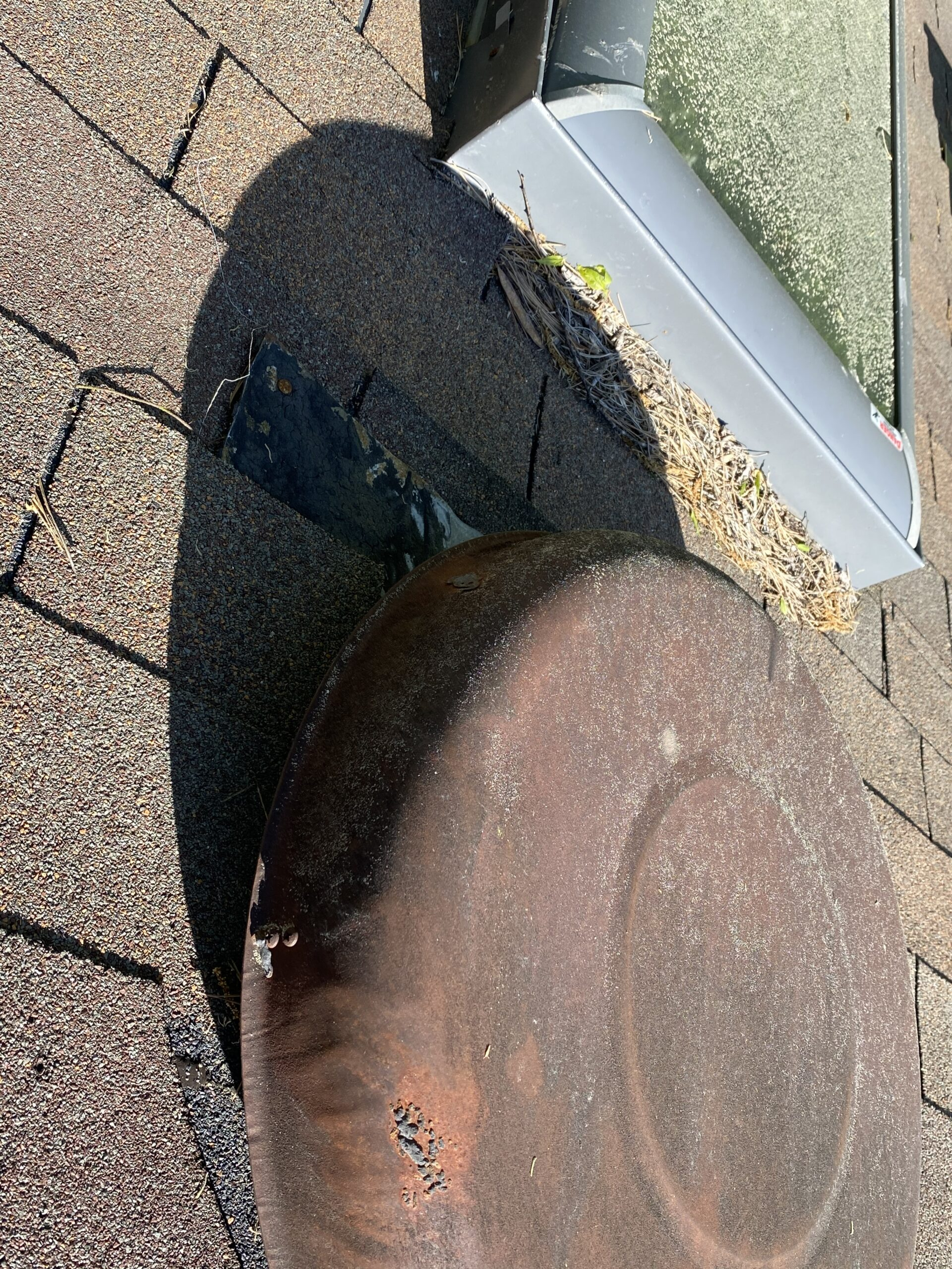 This is a picture of a vent on a roof that needs to be recondtioned