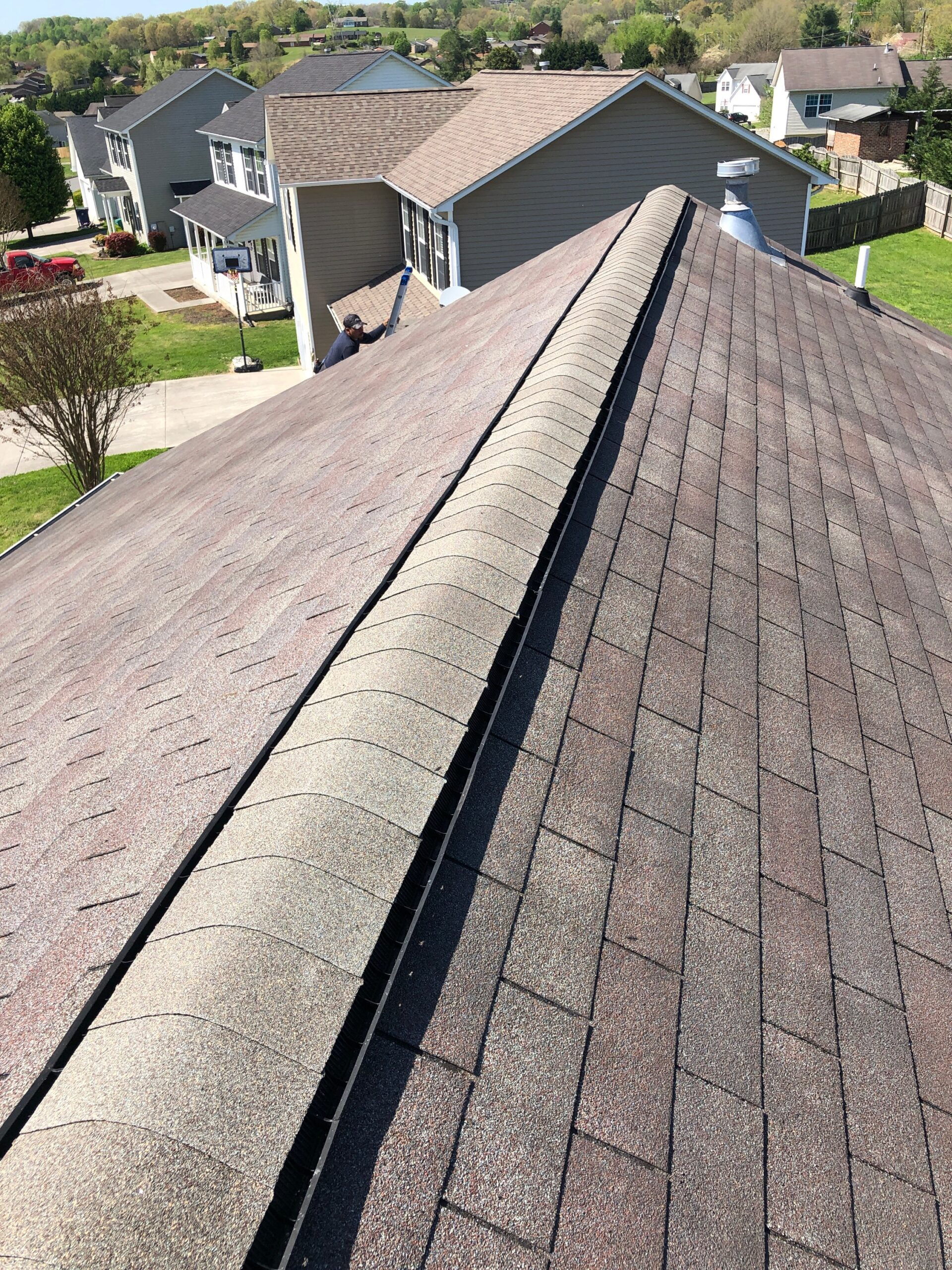 Grey colored shingle that goes over ridge vent