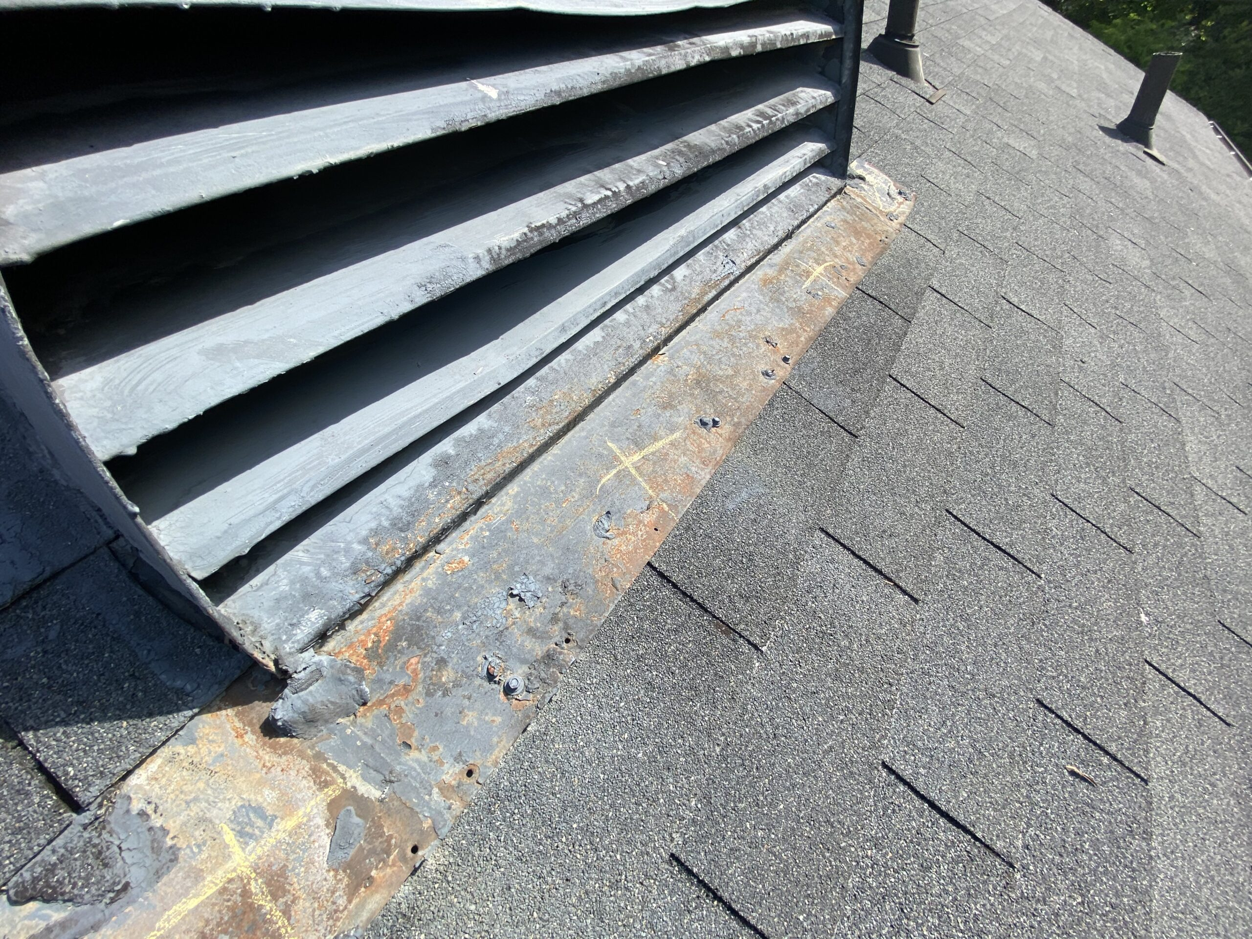 This is a picture of an old roof vent with seams that are cracking