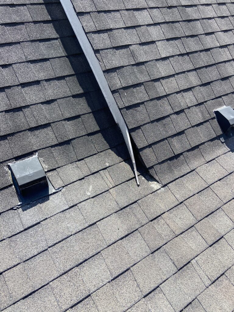 Image shows broken gutter and improperly installed that will cause leaks. Timberline shingles.