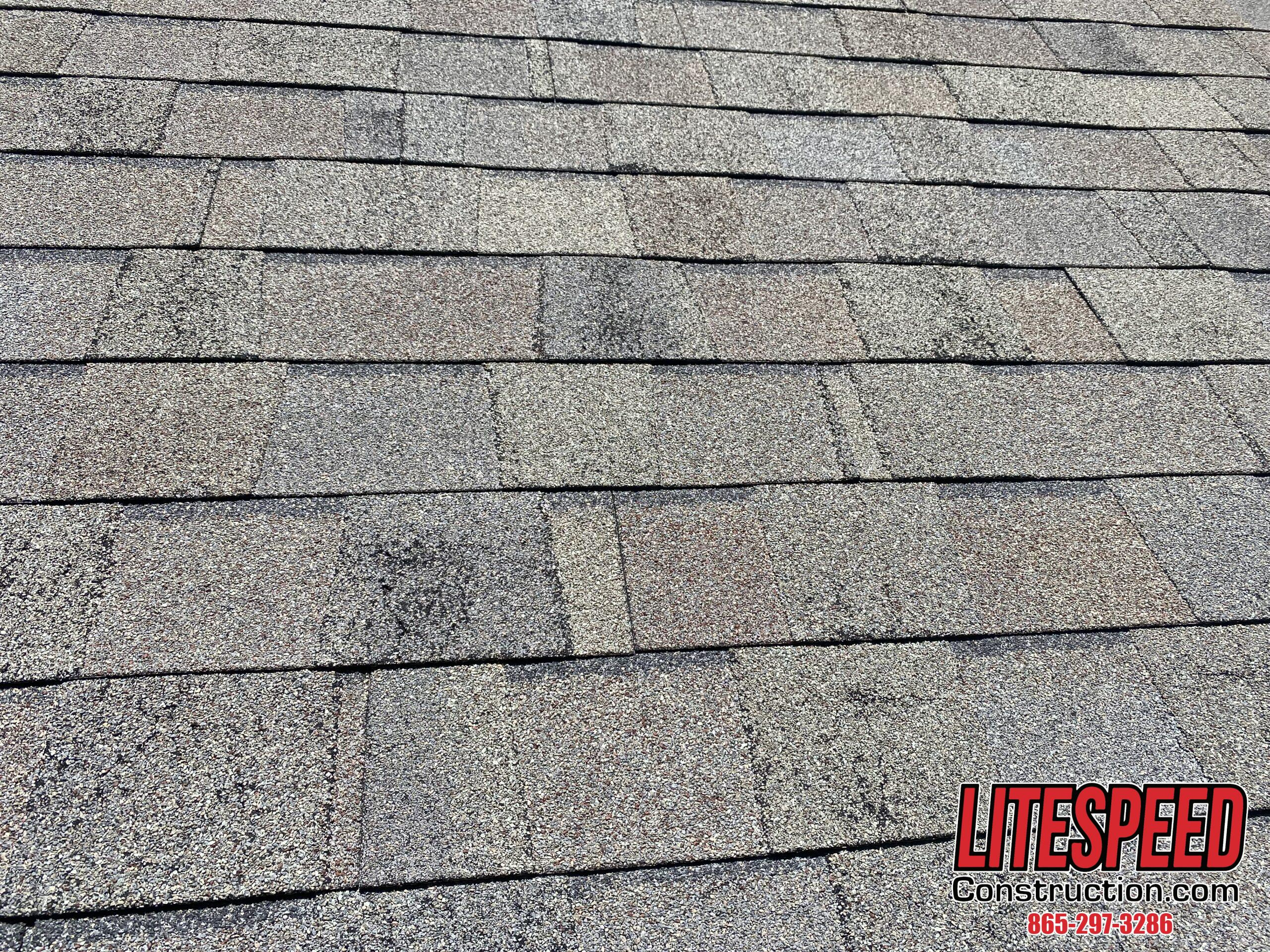 This is a picture of shingles that have granule loss on them