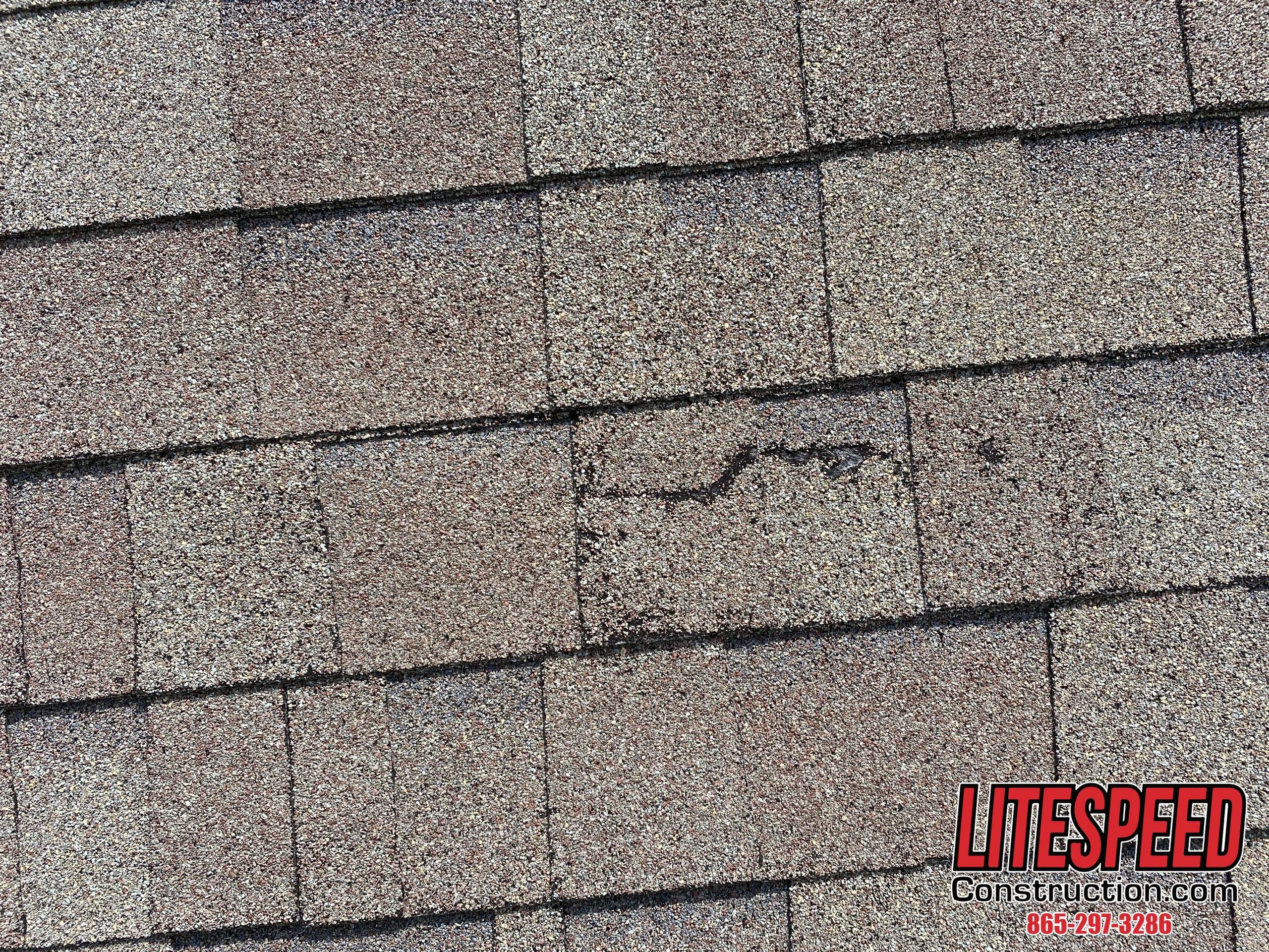 This is a picture of a crack on a shingle that needs to be sealed