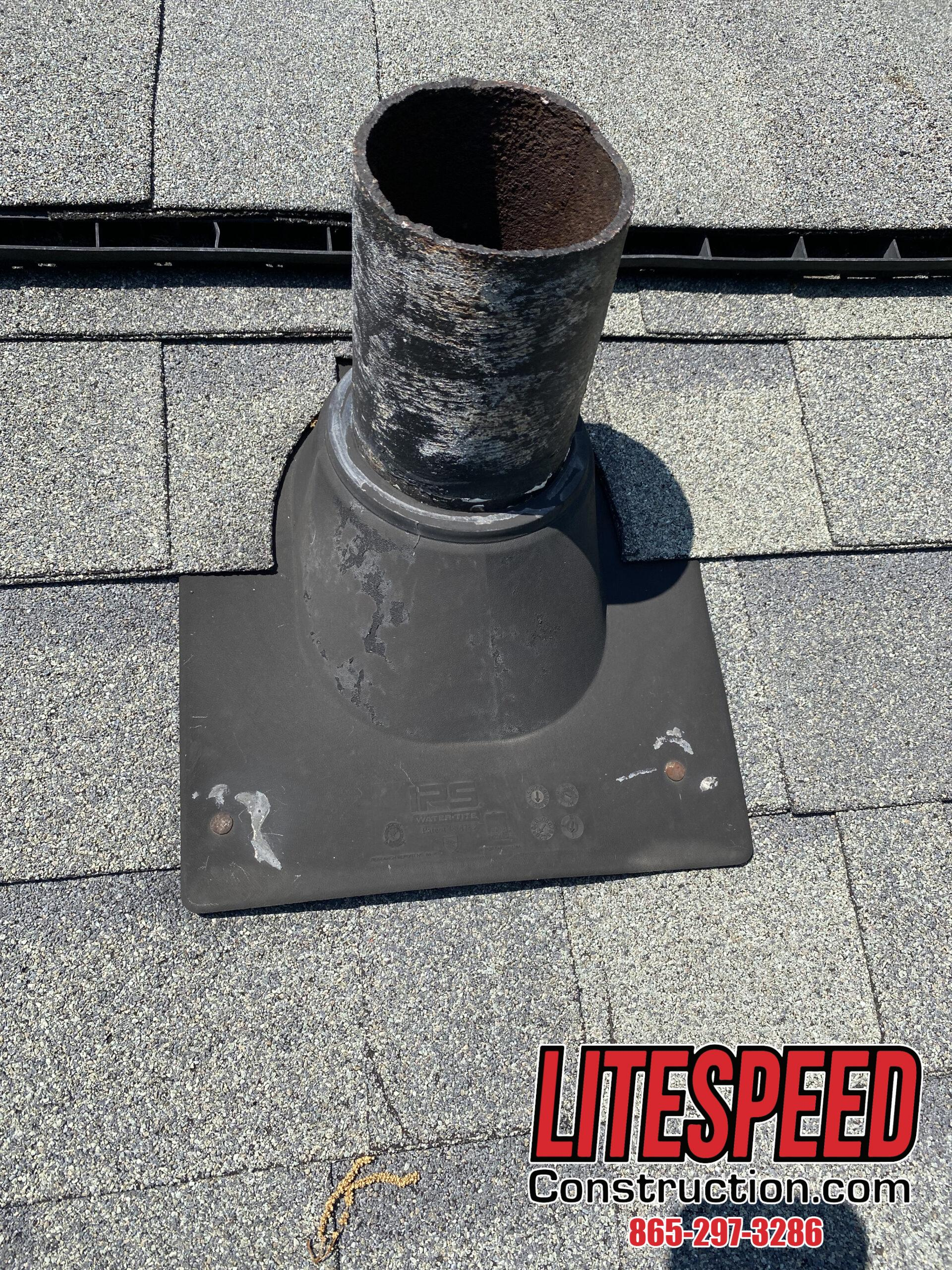this is a picture of an older black pipe boot on a gray dimensional shingle roof