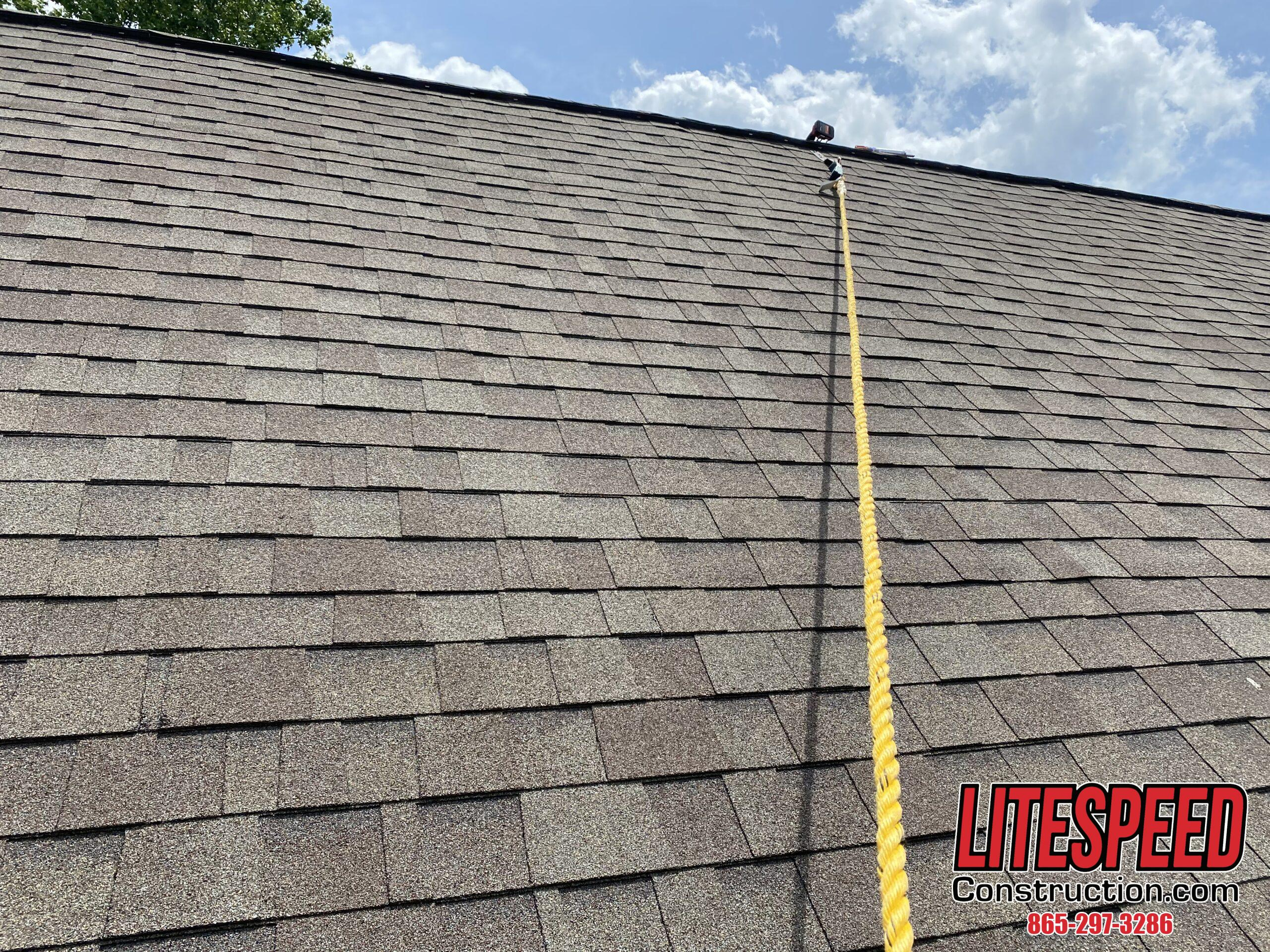 This is a picture of shingles in good shape with a rope in the middle
