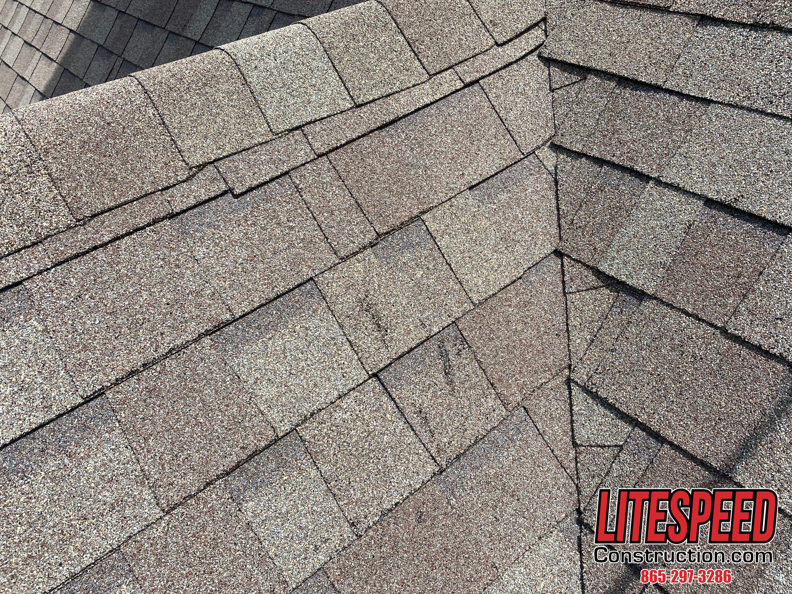 This is a picture of shingles with a little bit of damage