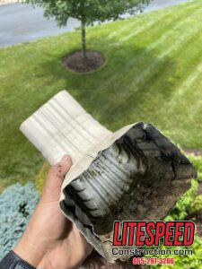 This is a picture of a downspout elbow that has been cleared