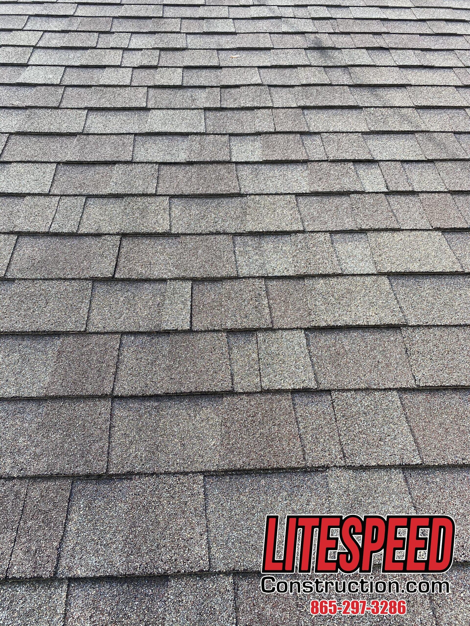 This is a picture of grayish brown shingles that are staggered correctly