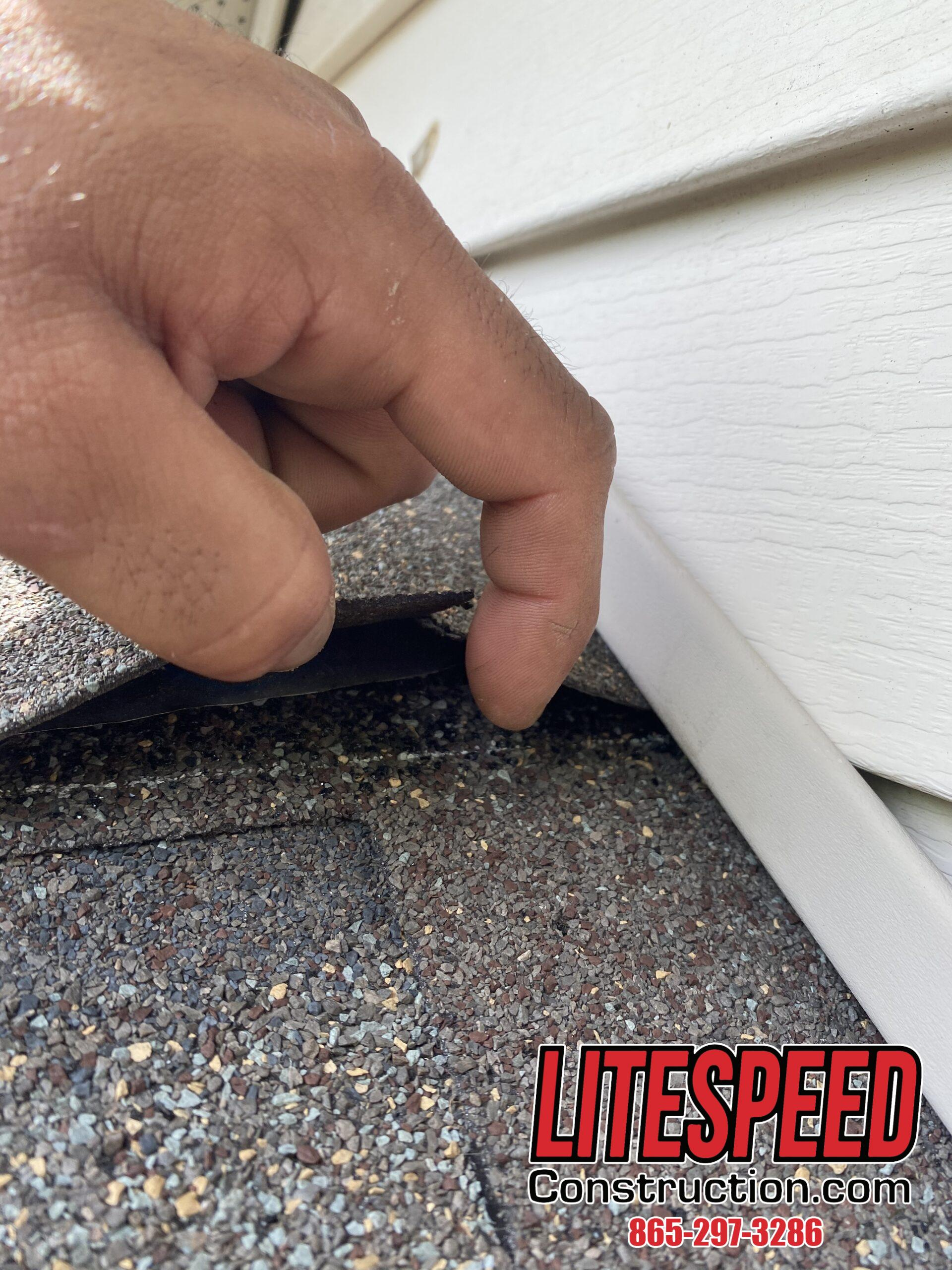This is a picture of shingles at a wall with step flashing underneath