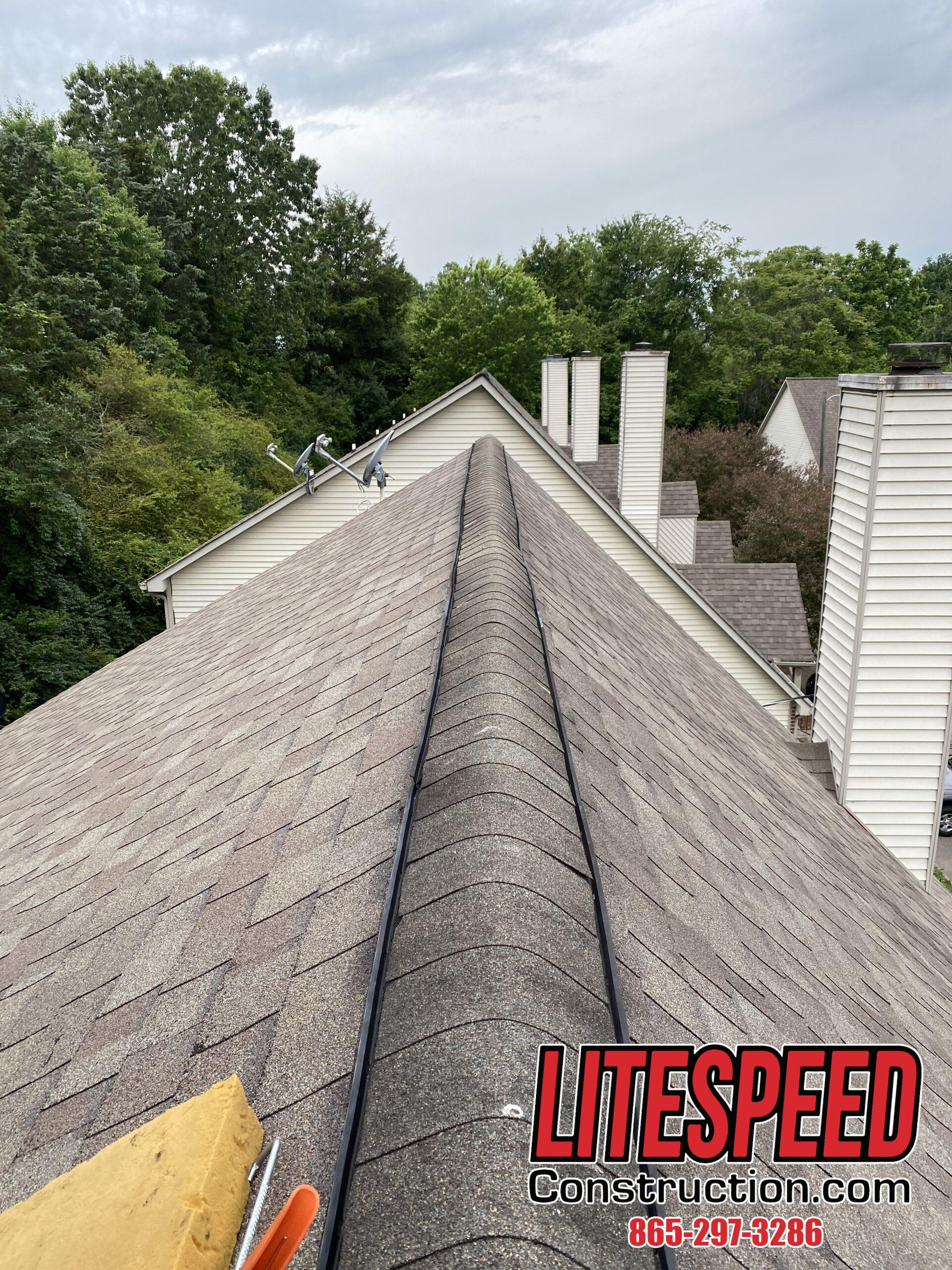 This is a picture of a ridge vent with ridge cap shingles