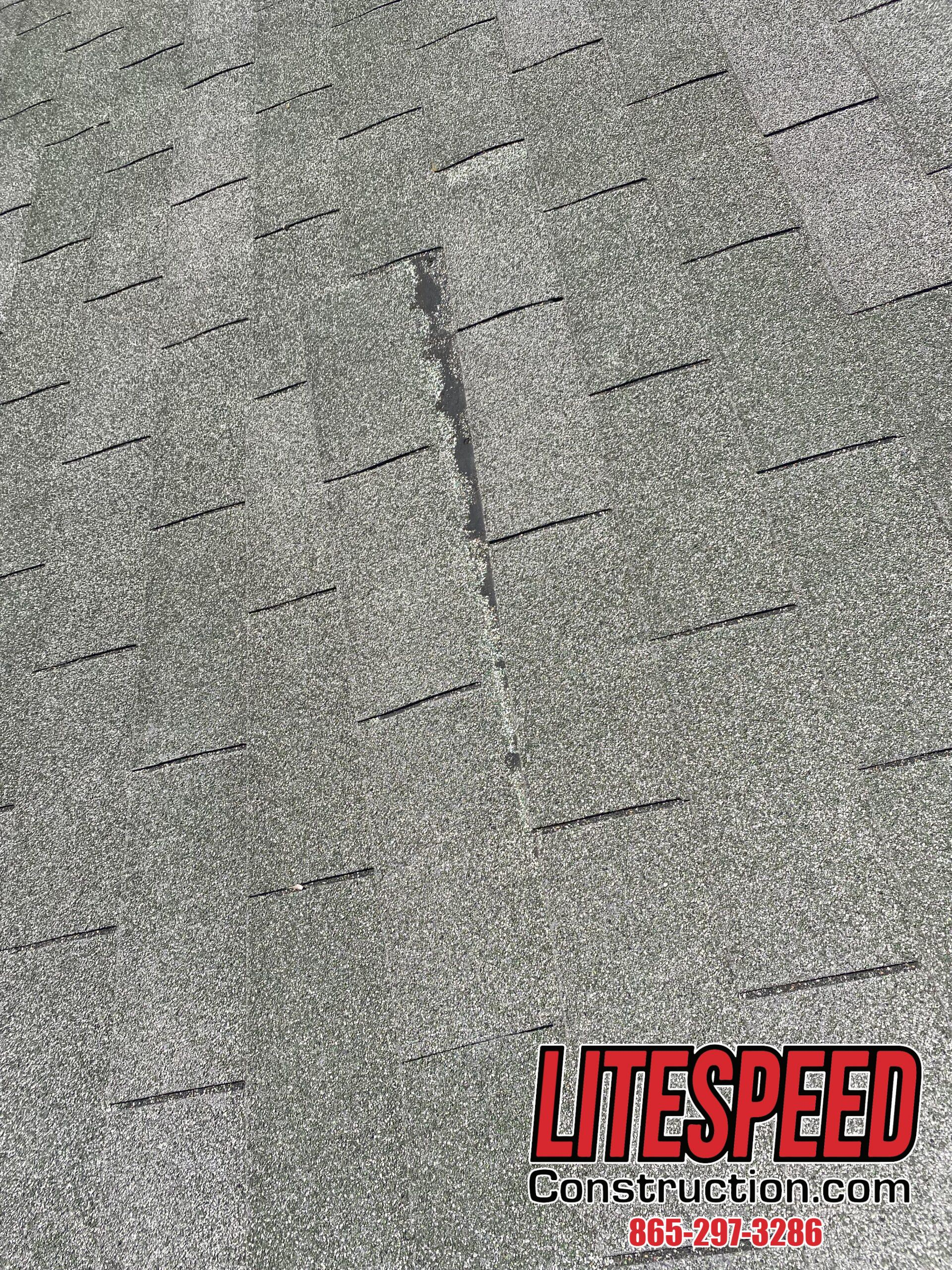 This is a picture of an old three tab roof with shingles sliding off