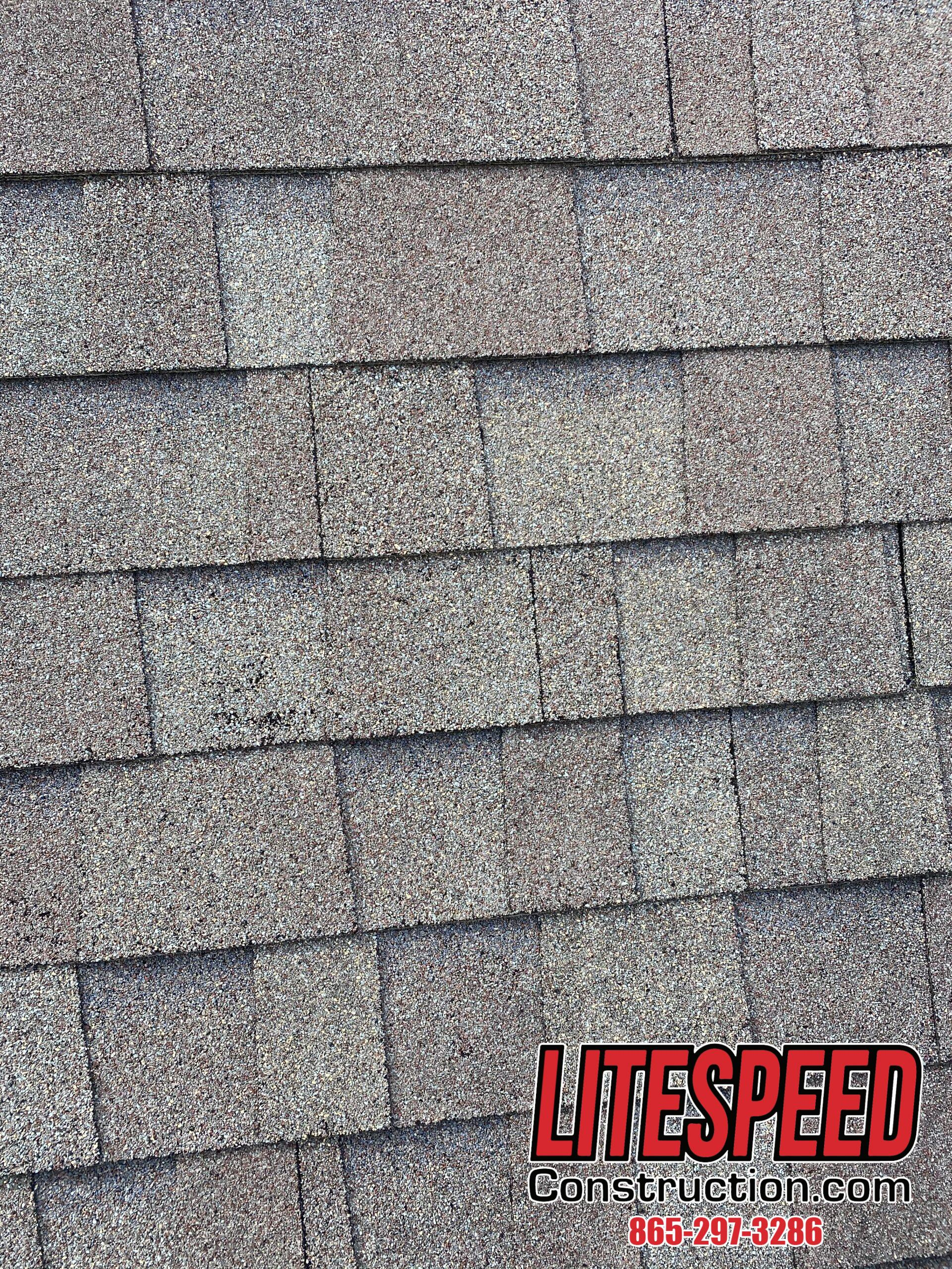 This is a picture of grayish brown shingles that are staggered correctly.