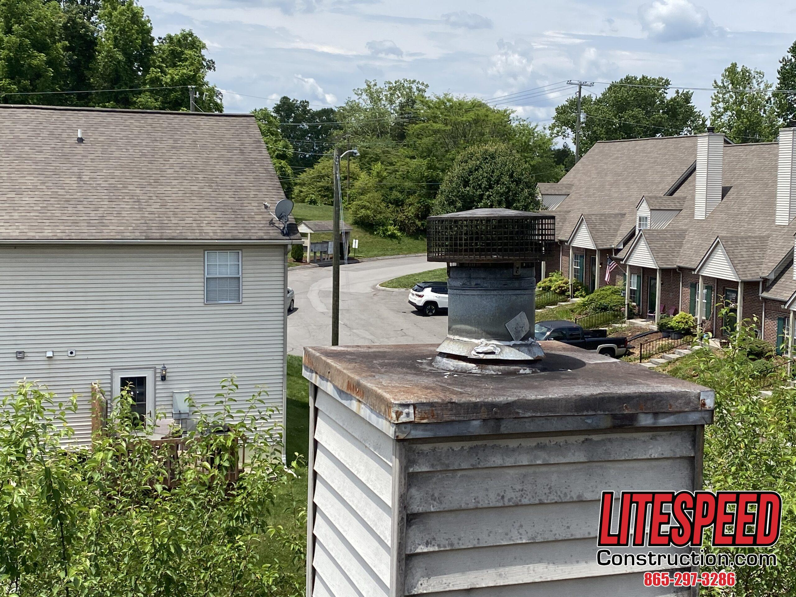 This is a picture of an old rusty chimney cap