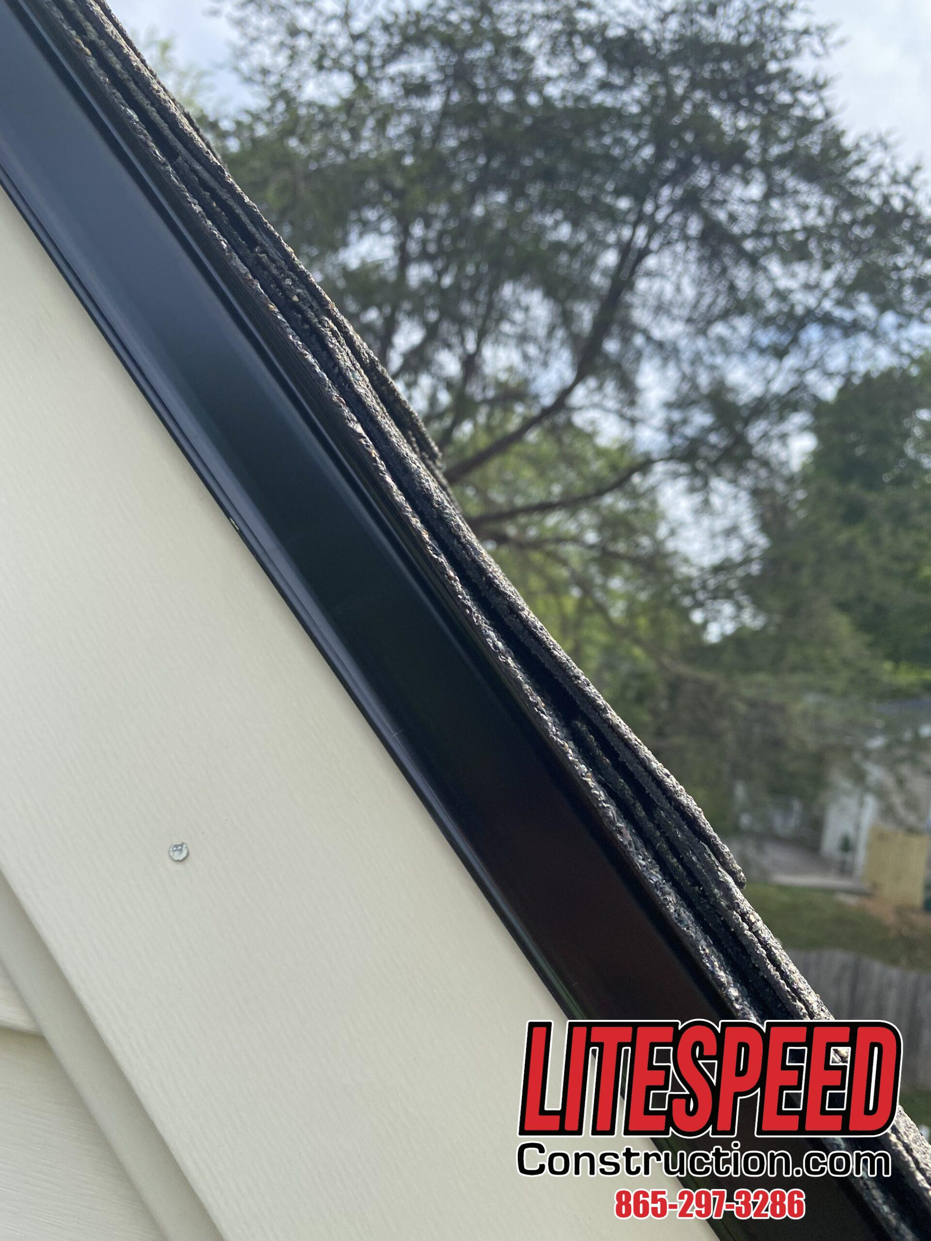 This is a picture of black drip edge under the shingles of a new roof