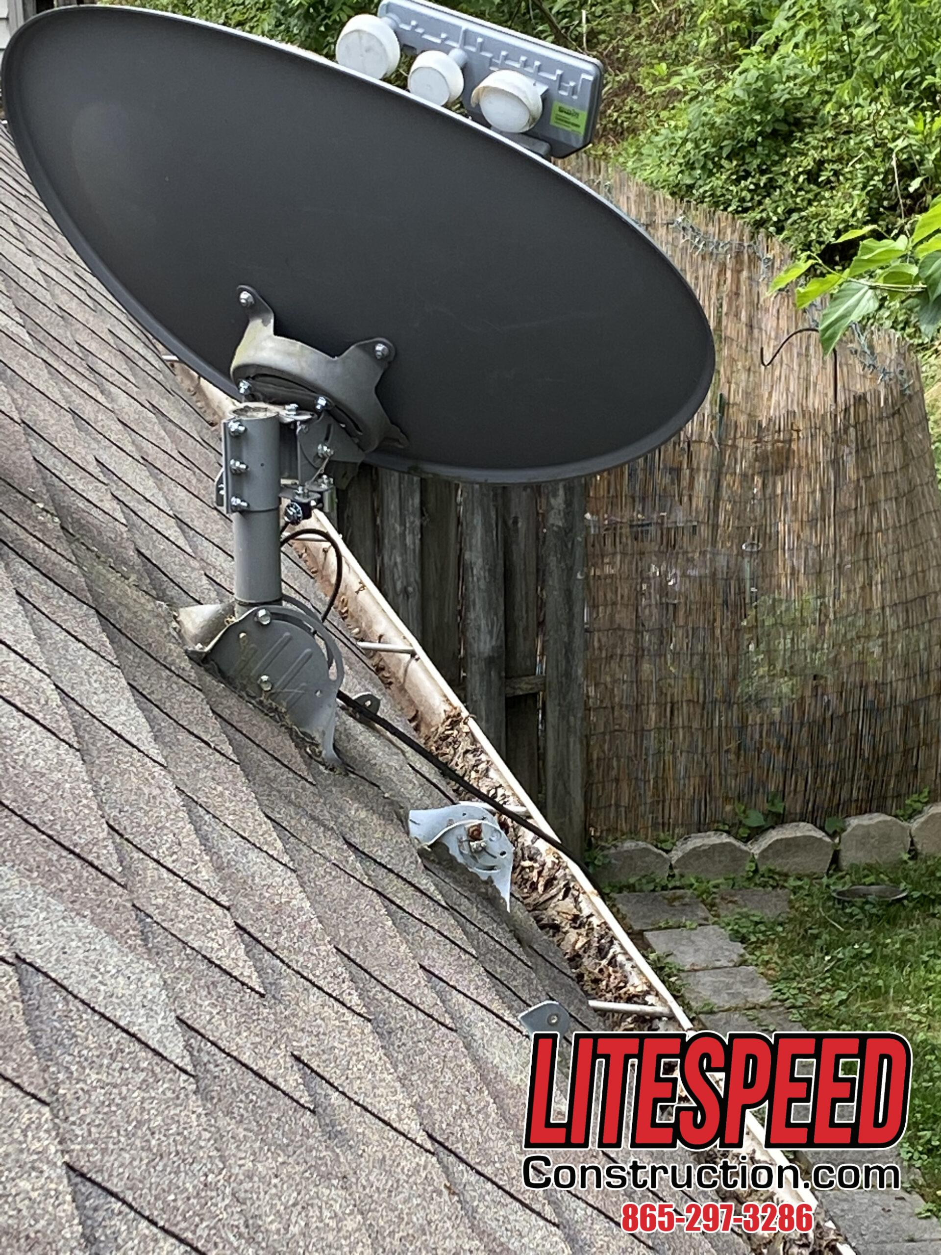 This is a picture of a satellite dish on a roof