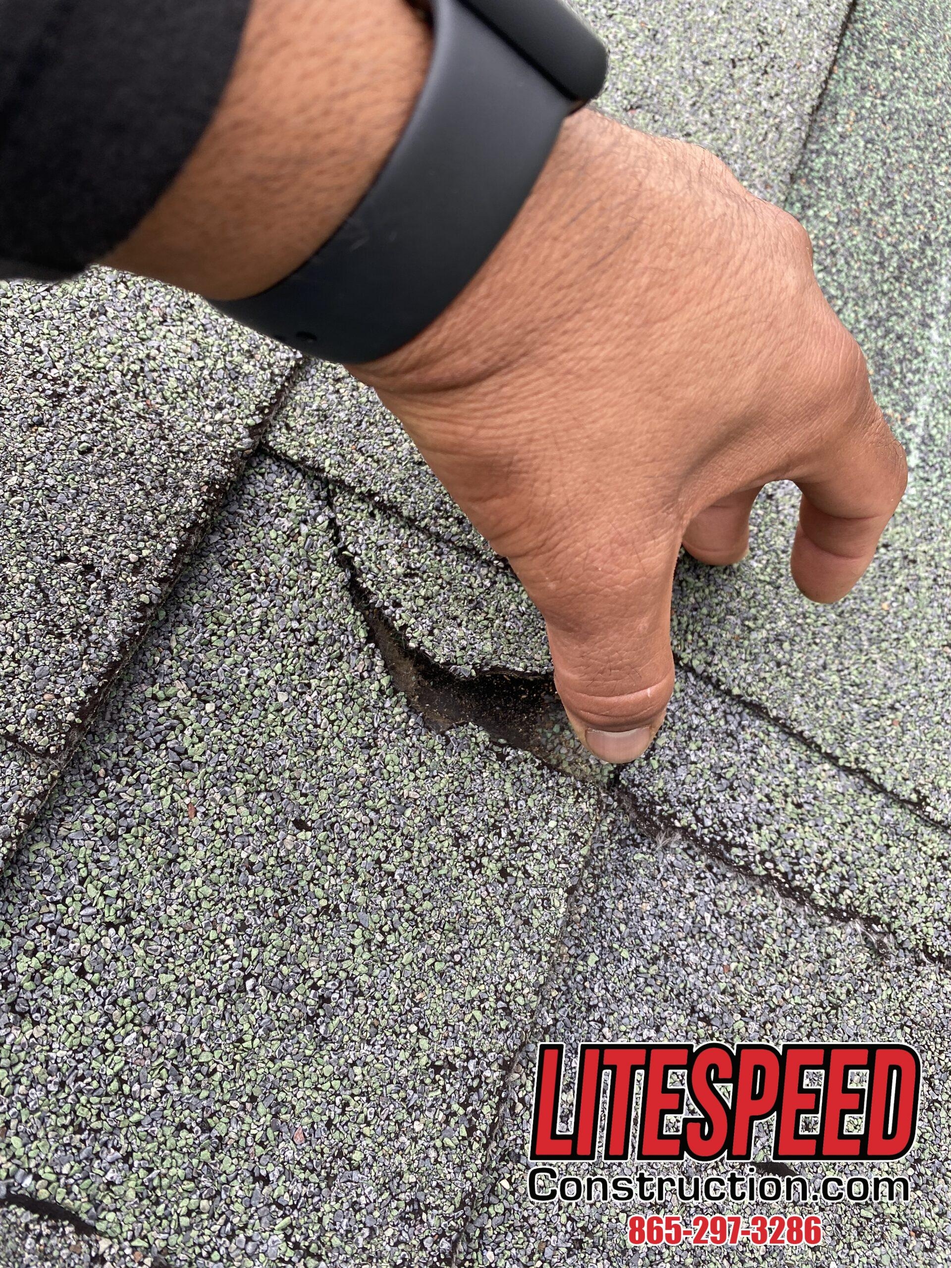 This is a picture of a green shingle that is broken.