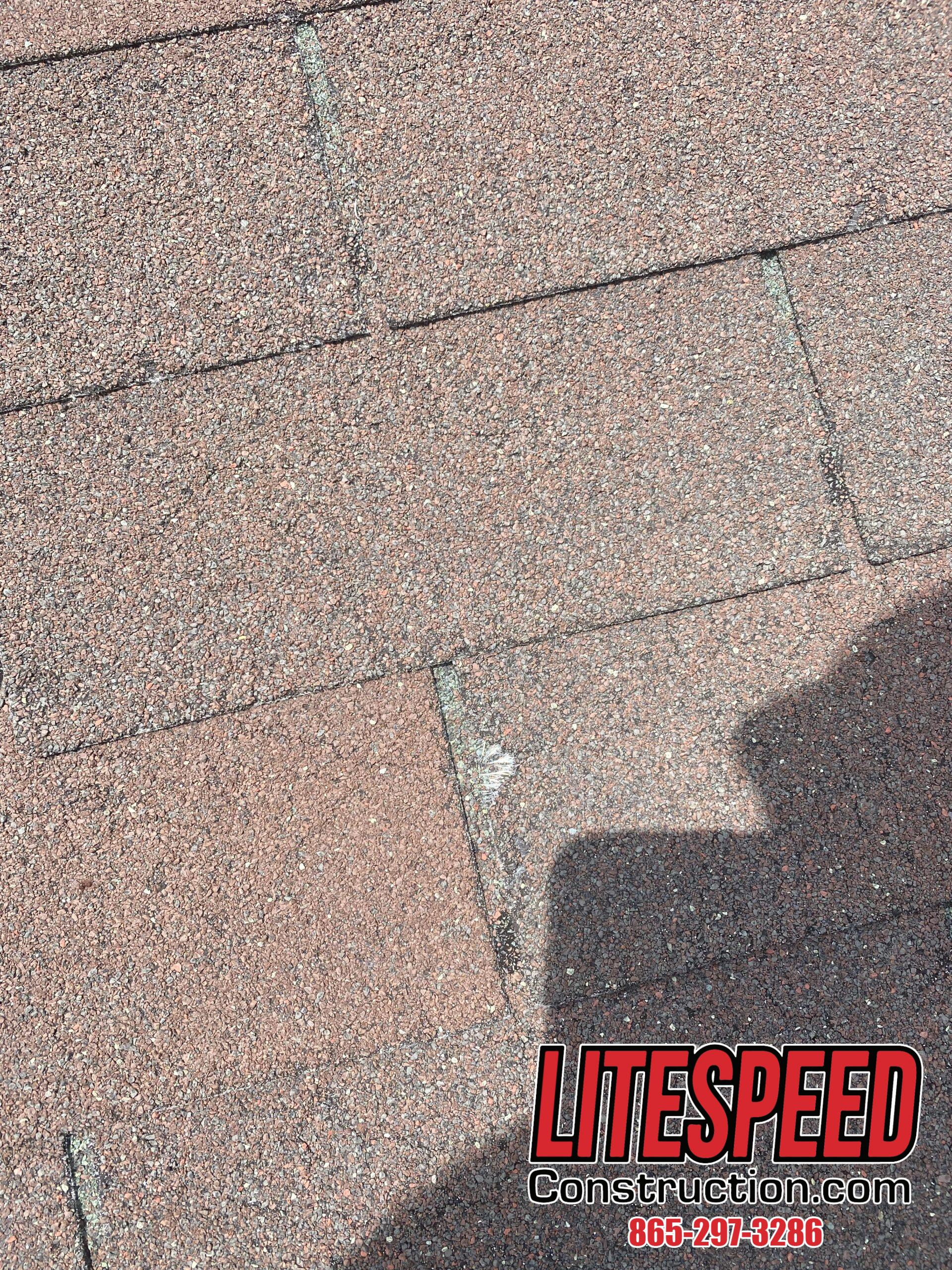 This is a picture of a shingle with a missing piece on the left side.