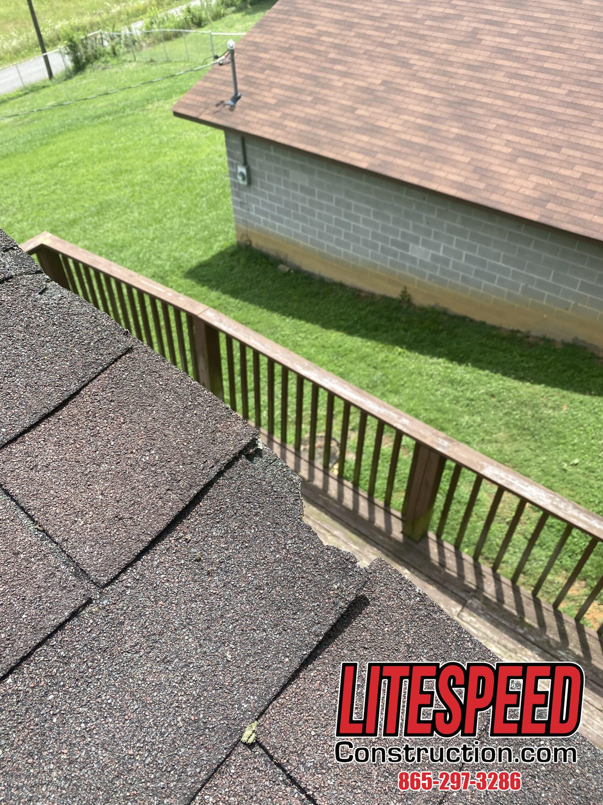 this is a picture of a three tab shingle at the edge of a roof that has broken off