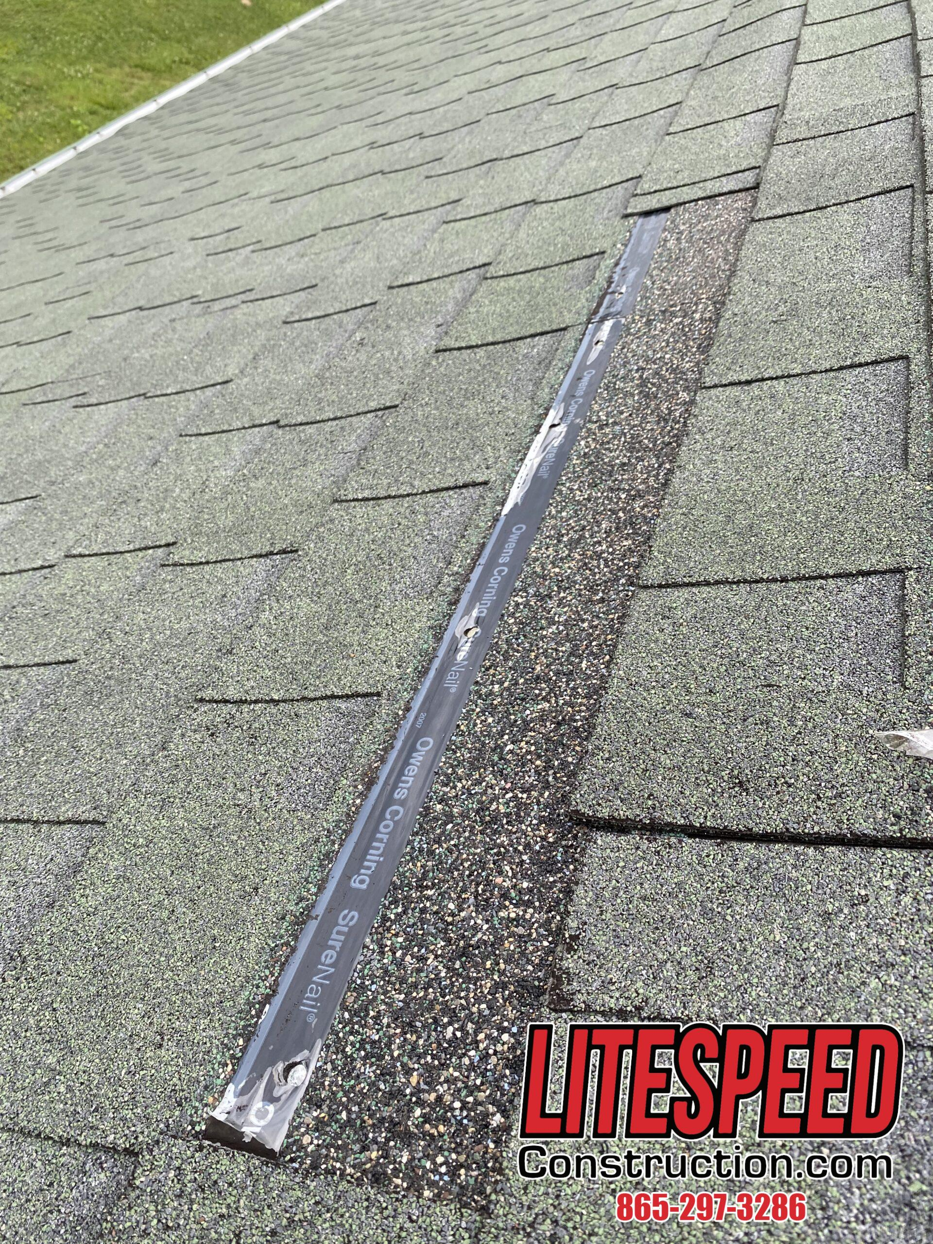 This is a picture of a green roof with missing shingles.