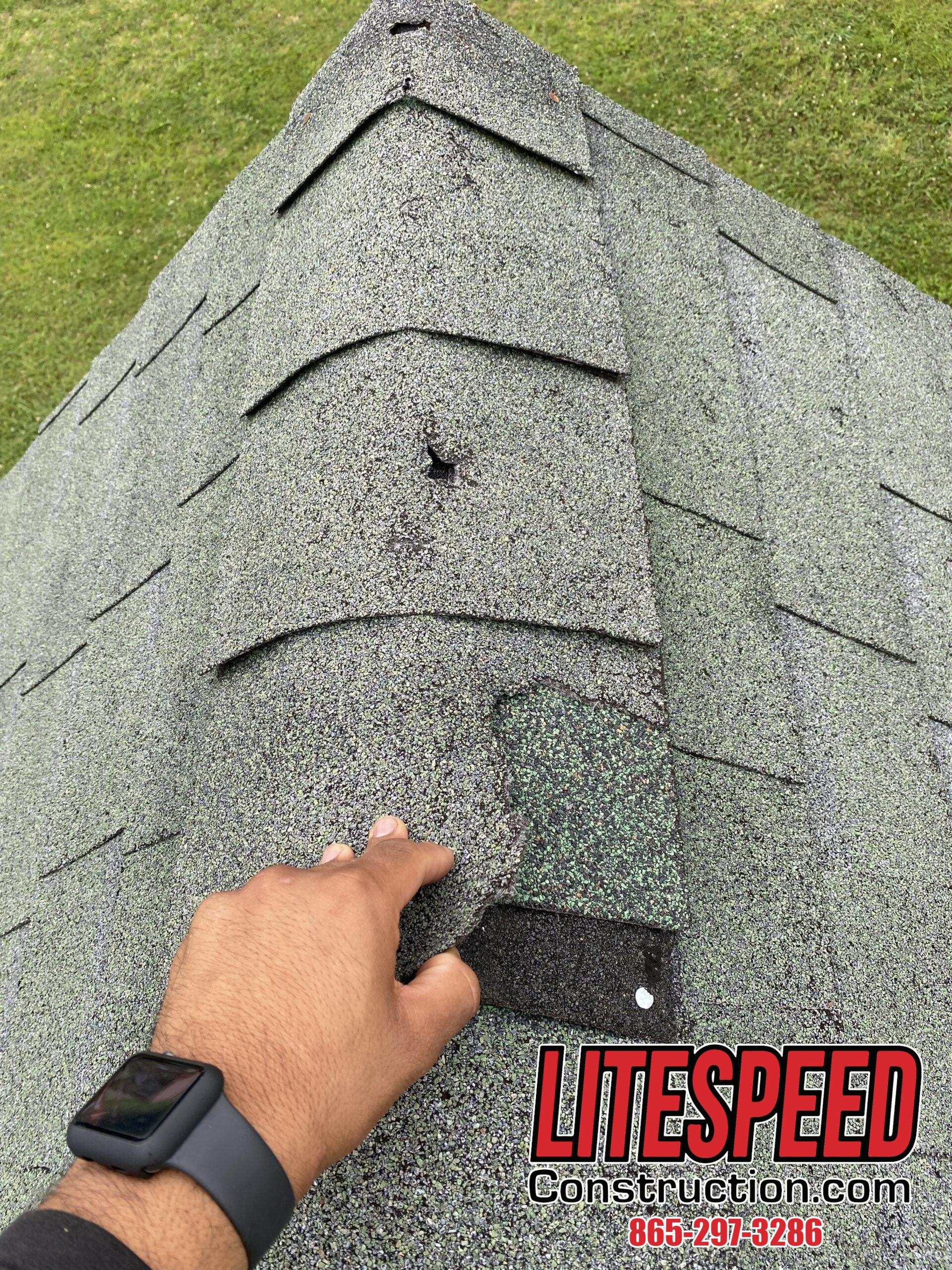 This is a picture of a green ridge cap shingle that is broken