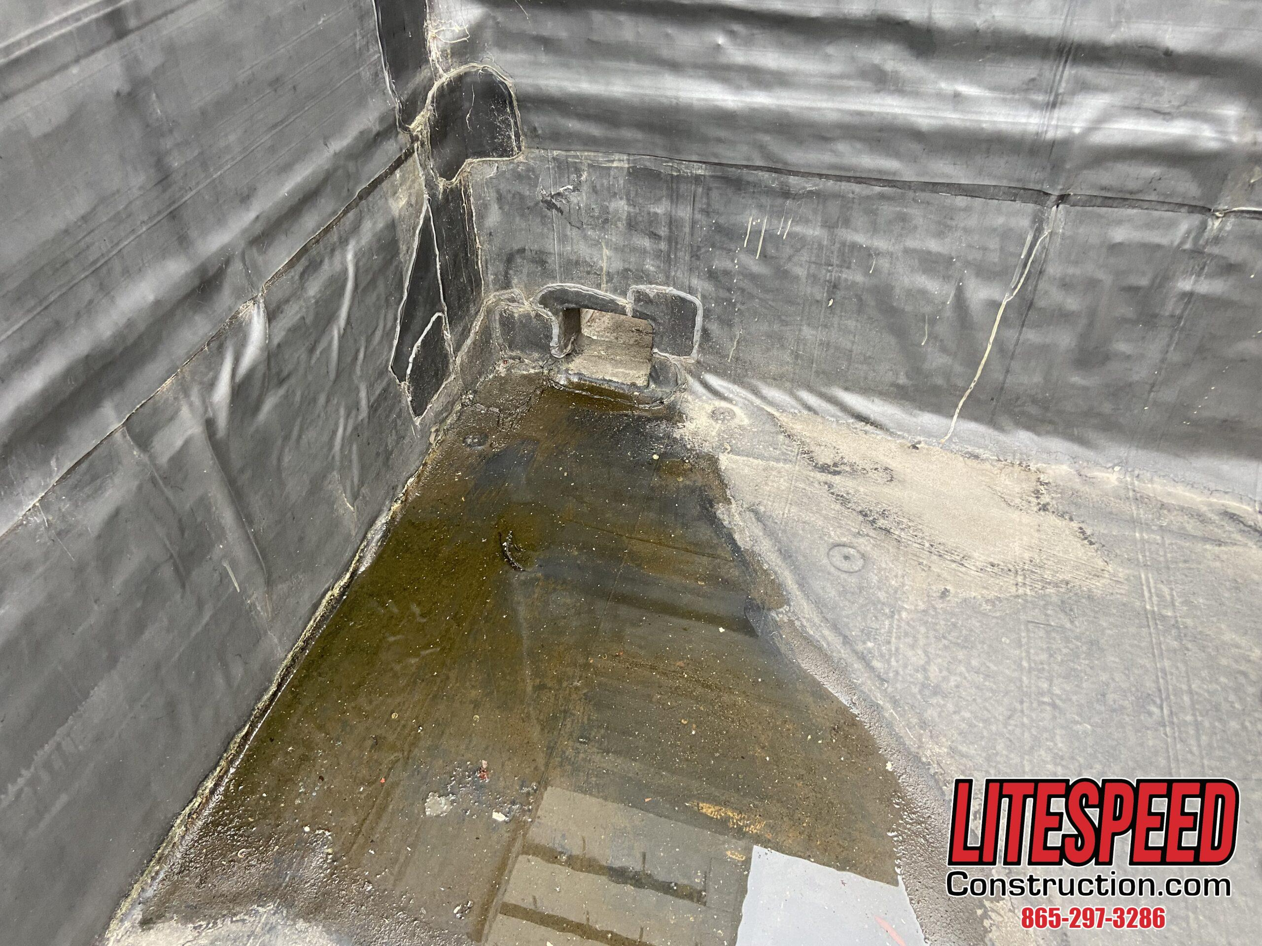 Standing water on commercial roof at a drain