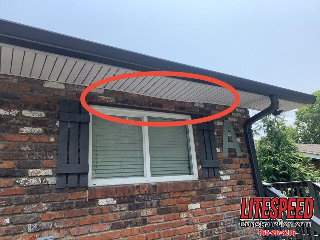 Repair and Replace Soffit in Knoxville TN This Vinyl Soffit Needs Repairs showing the warped piece of white vinyl